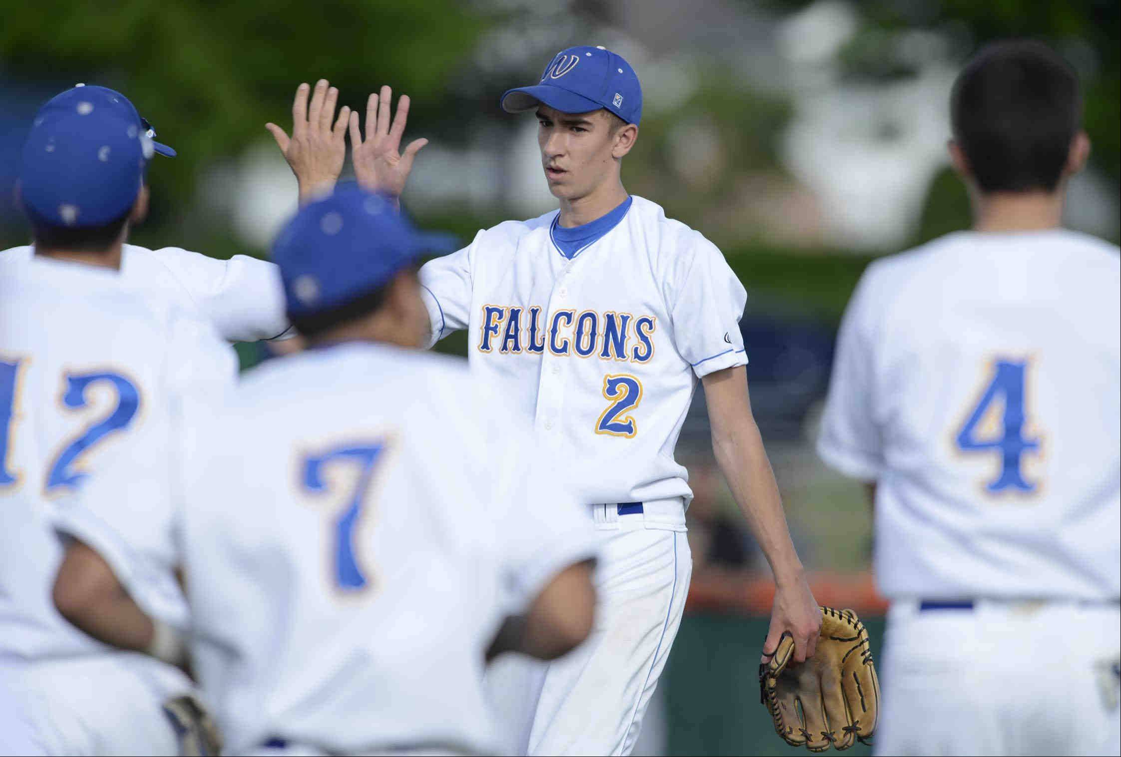 Wheaton North starting pitcher Doug Hayes comes off the mound at the end of the sixth inning against Bartlett Thursday in the St. Charles East sectional game. He won the game 4-1.