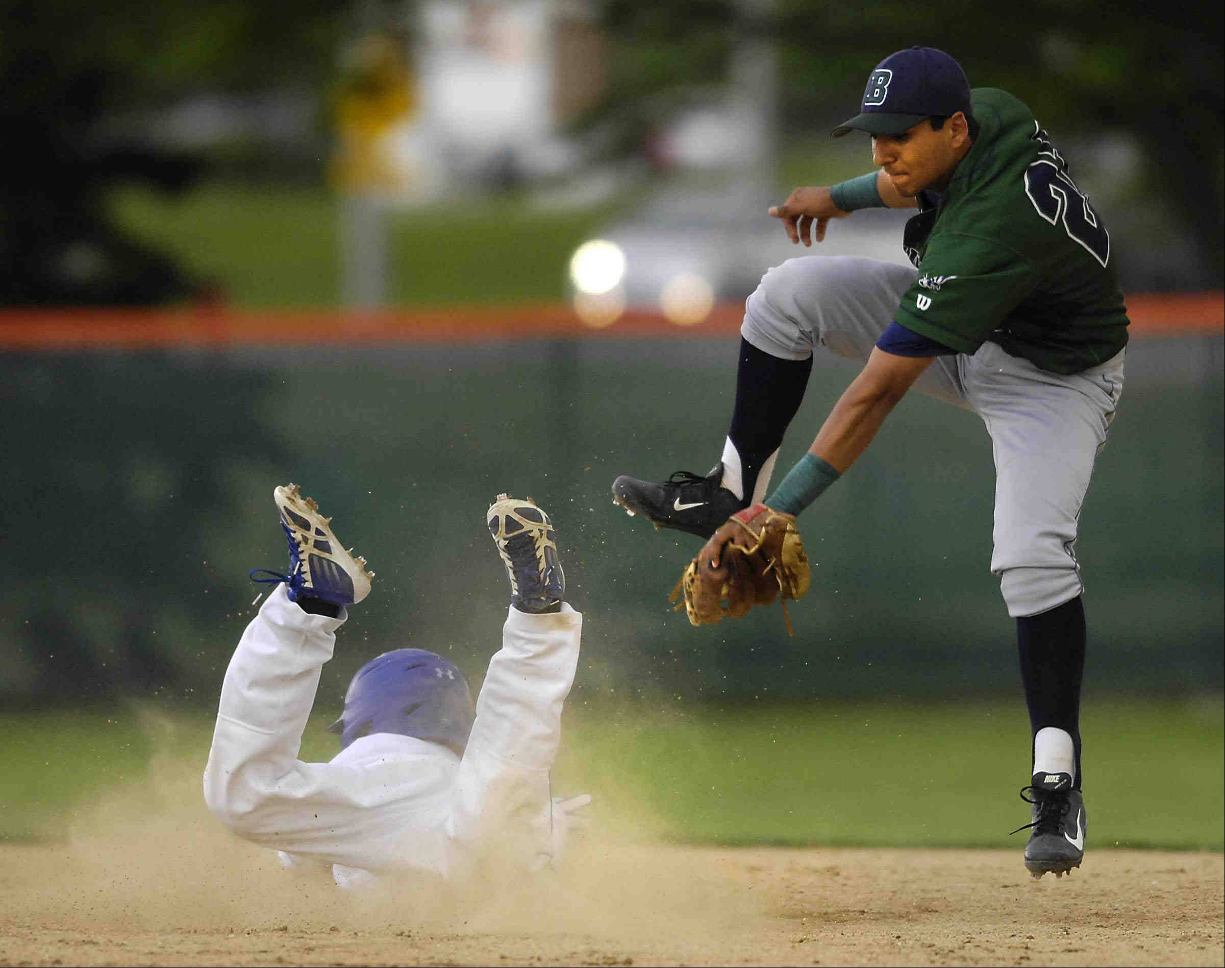 Bartlett's Sam Franco can't reach Wheaton North's Jacob Taschetta as he steals second base Thursday in the St. Charles East sectional game.