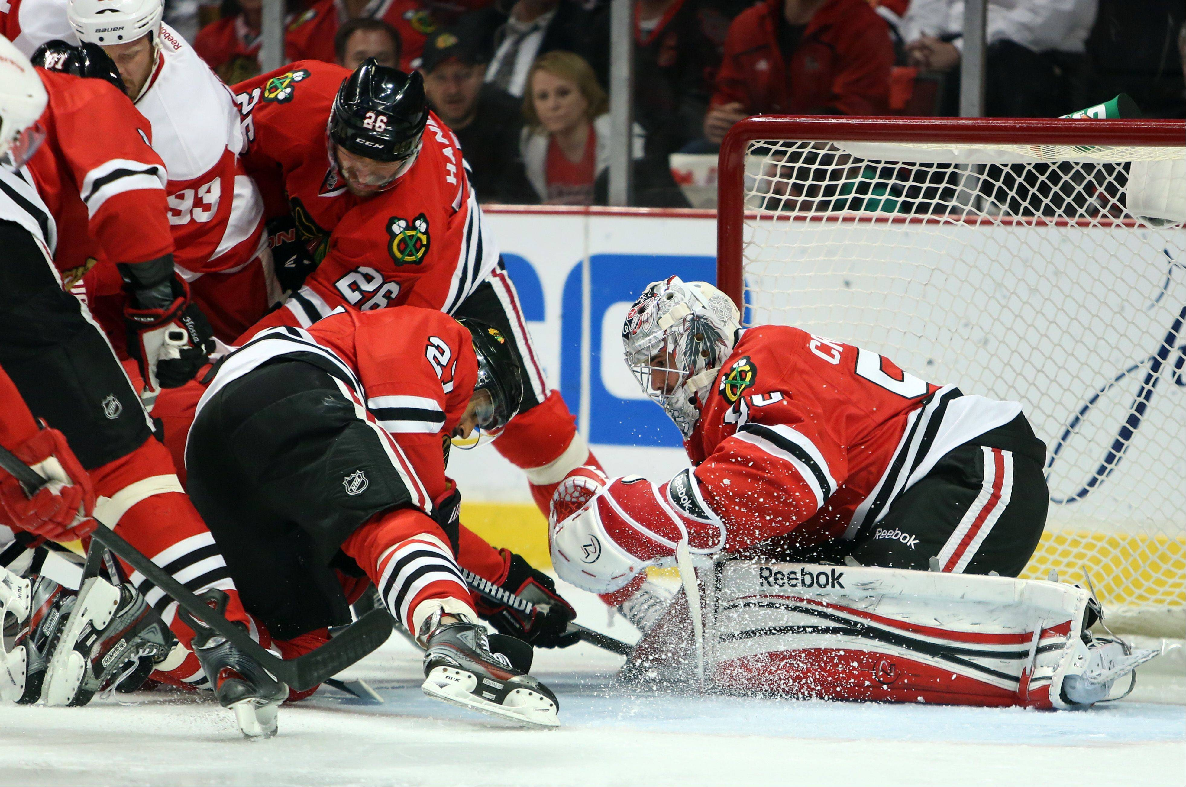 Blackhawks goalie Corey Crawford makes a save during game 7 of the Western Conference semifinals between the Chicago Blackhawks and the Detroit Red Wings on Wednesday, May 29, at the United Center in Chicago.
