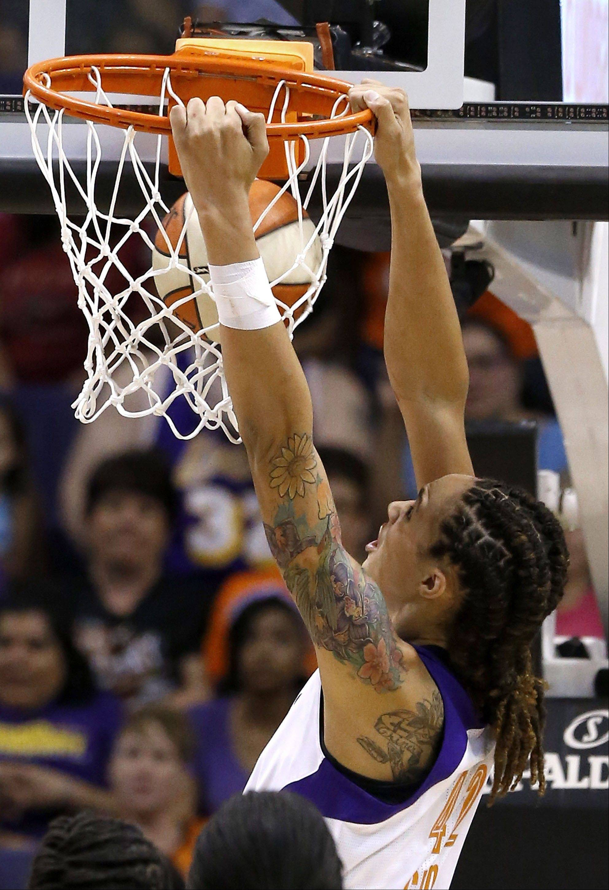 Phoenix Mercury's Brittney Griner goes in for a break away dunk against the Chicago Sky on Monday. Griner had two dunks in the 102-80 loss by the Mercury.