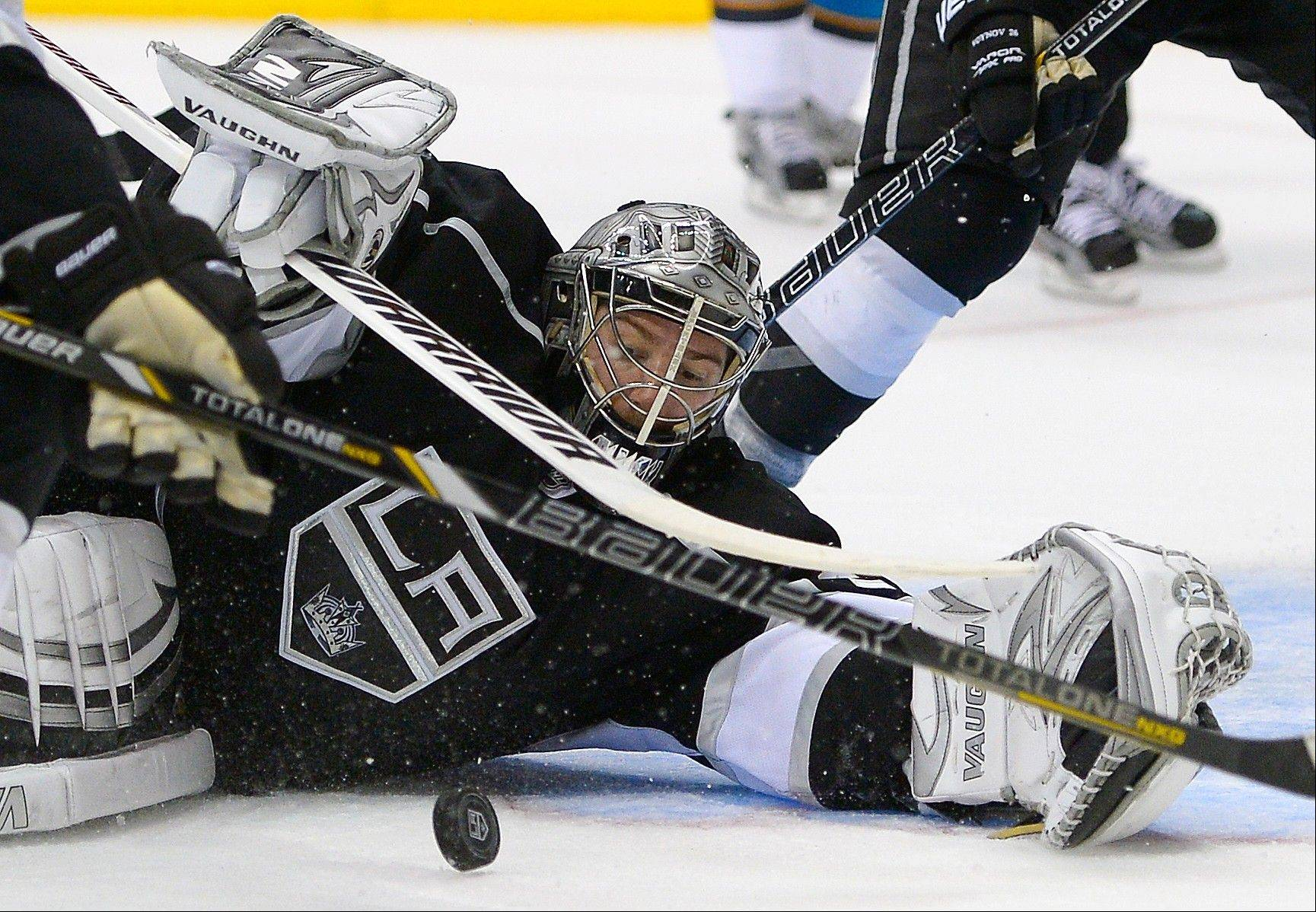 Los Angeles Kings goalie Jonathan Quick makes a save Tuesday against the San Jose Sharks during the third period in Game 7 of the Western Conference semifinals in Los Angeles.