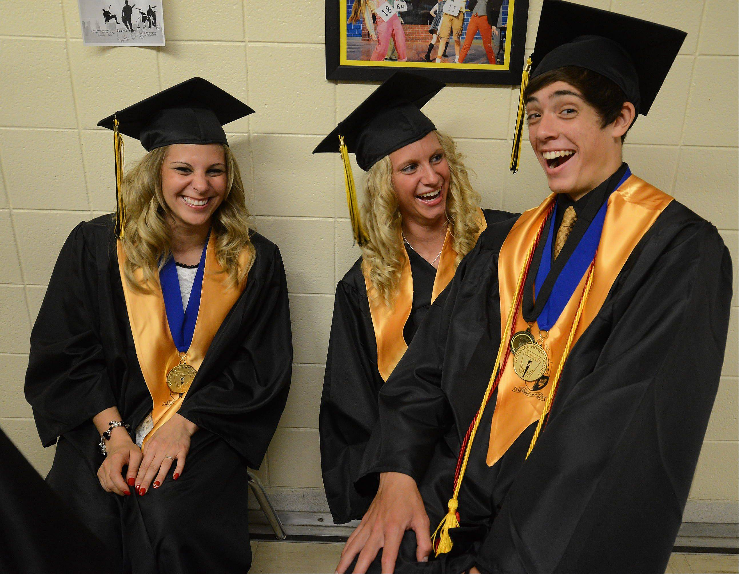 From left, Nicole Krippinger, Rachael Wahrman and Matt Krzyzaniak pass the time while waiting for the Glenbard North High School graduation to begin.