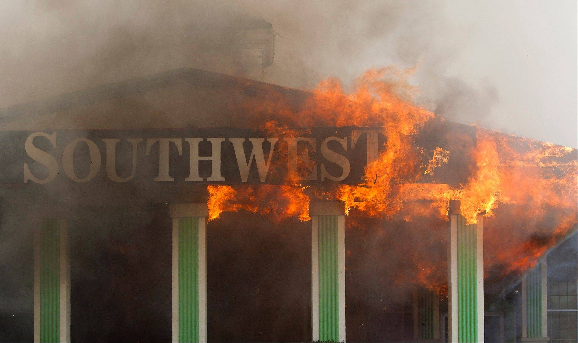 Flames erupt Friday from the Southwest Inn on U.S. 59 in Houston.