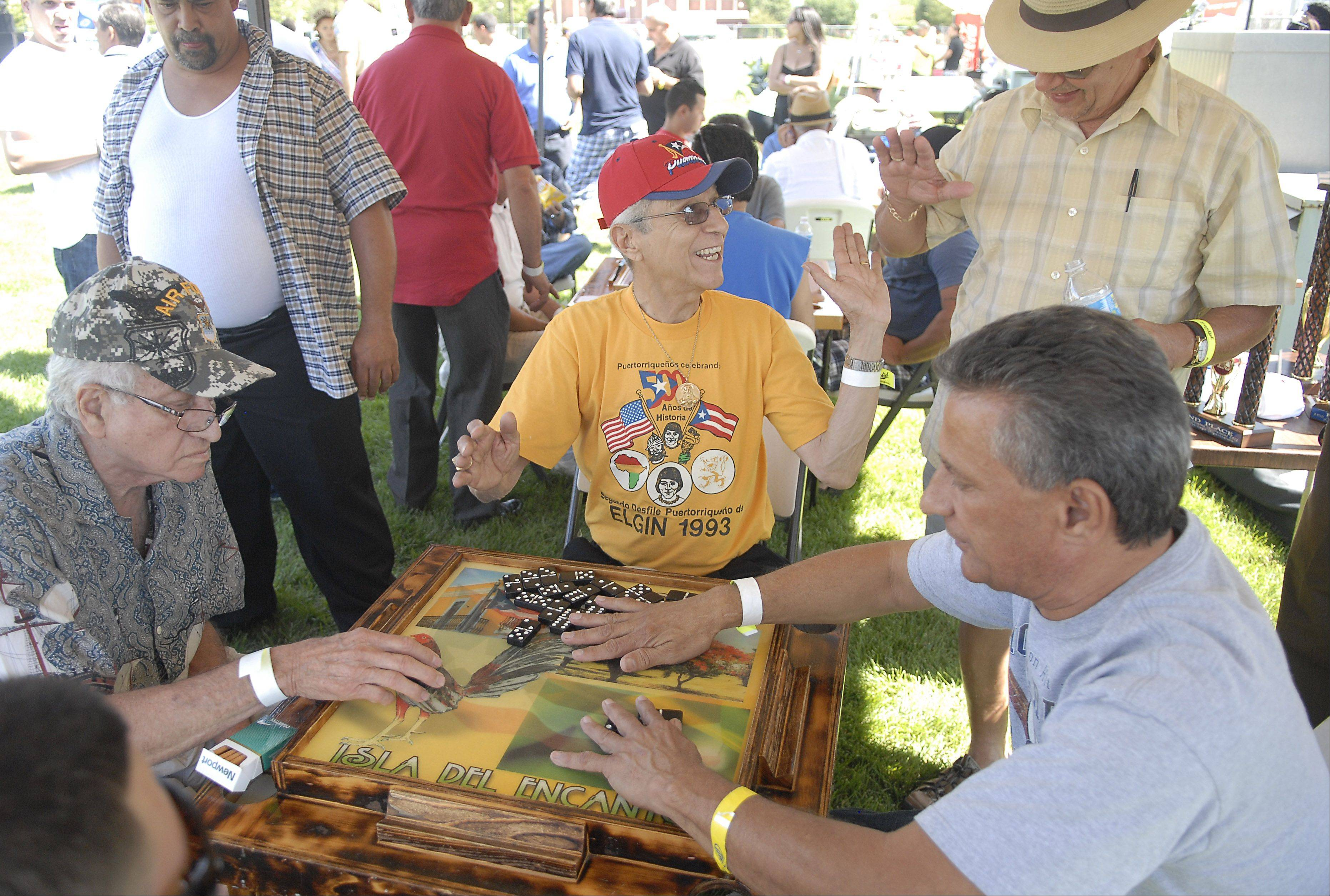 The traditional domino tournament, pictured at last year's BoriquaFest in Elgin, might be part of Elgin's iFest in late August.