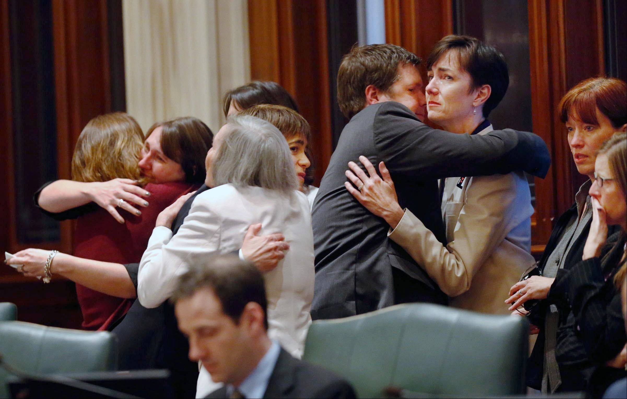 Rep. Kelly Cassidy, D-Chicago, right, and other supporters of gay marriage are consoled by friends and colleagues after a bill legalizing gay marriage in Illinois wasnít called for a vote Friday, May 31, 2013 in Springfield, Ill. (AP Photo/The State Journal-Register, Ted Schurter)