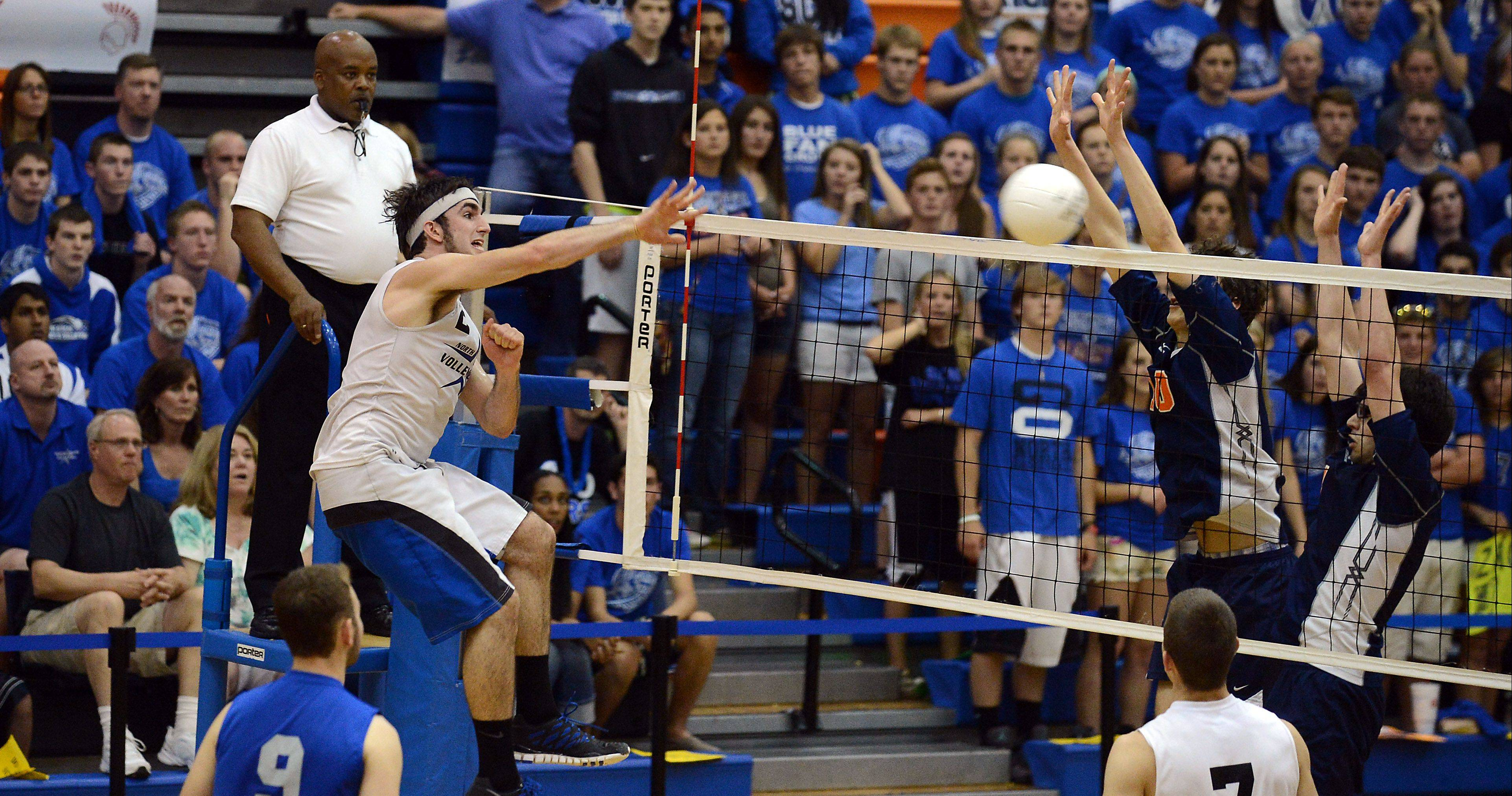 Johathan Orech, who led St. Charles North with 15 kills, spikes the ball past Oak Park at the boys volleyball state finals at Hoffman Estates High School Friday.