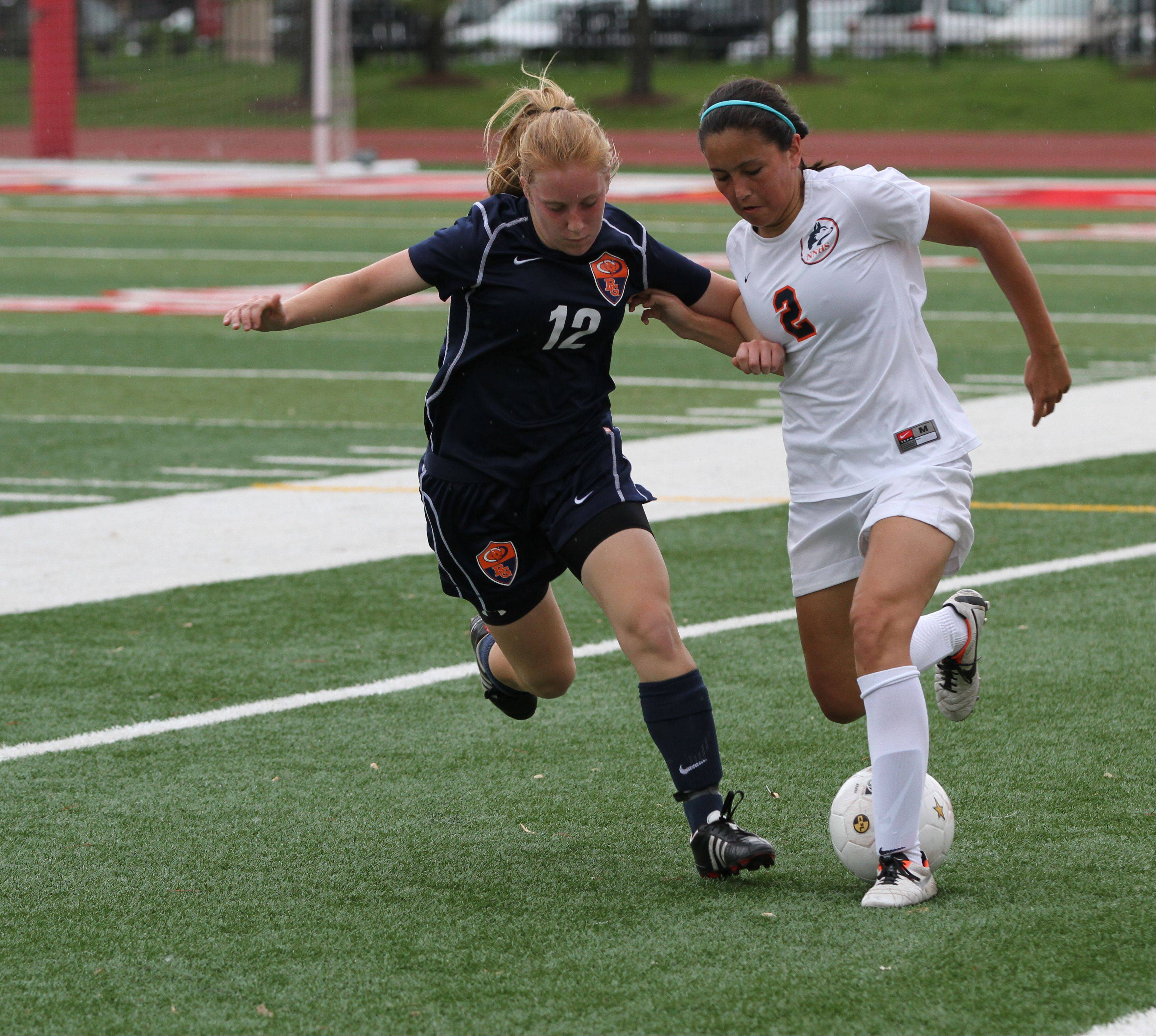 Buffalo Grove High School midfield Colleen Zickert (left) battles for the ball against Naperville North High School midfield Meghan Lee at the girl soccer state semi-final game on Friday, May 31, 2013 at North Central College in Naperville, Ill.