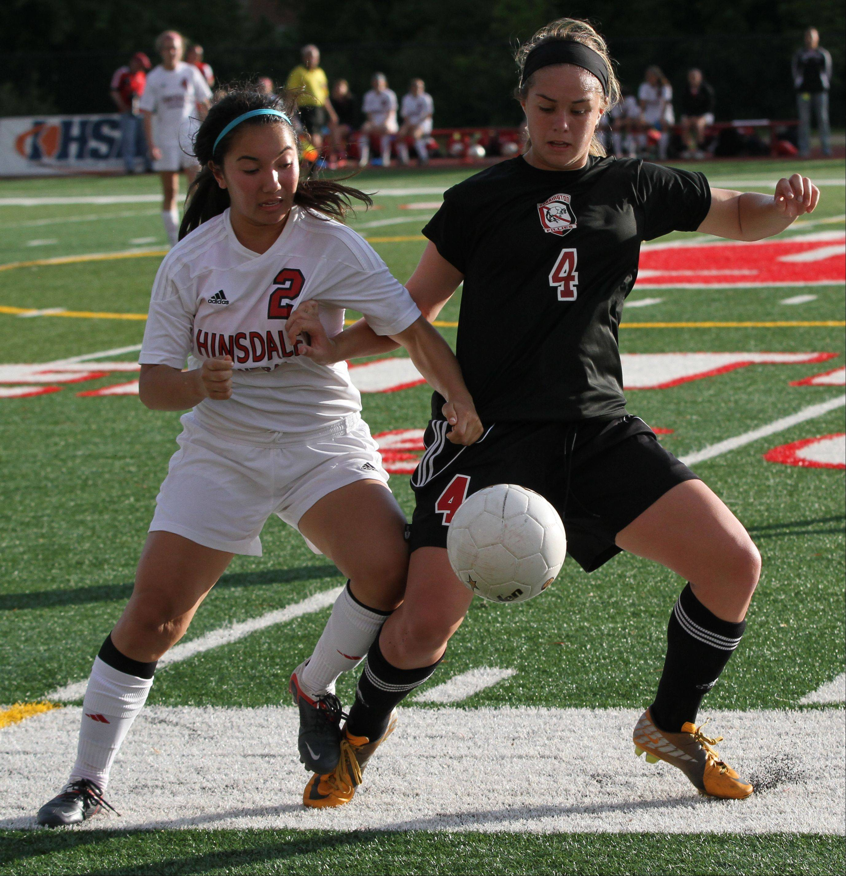 Hinsdale Central's Alison Cerny, left, battles Barrington's Mia Calamari for the ball in the Class 3A girls soccer state semifinals Friday at North Central College.