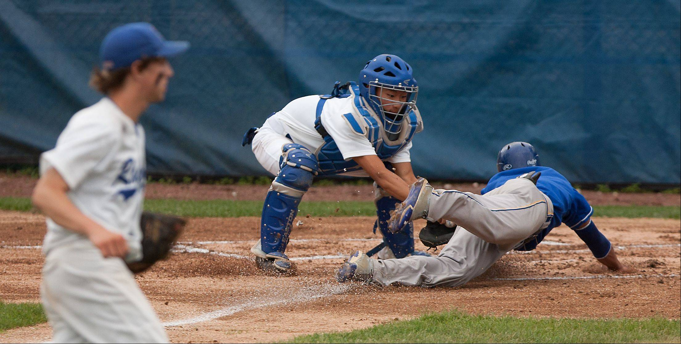 Glenbard South catcher Will Cornwell tags out Clemente's Pedro Vasquez during the Nazareth Class 4A sectional semifinals in LaGrange Park.