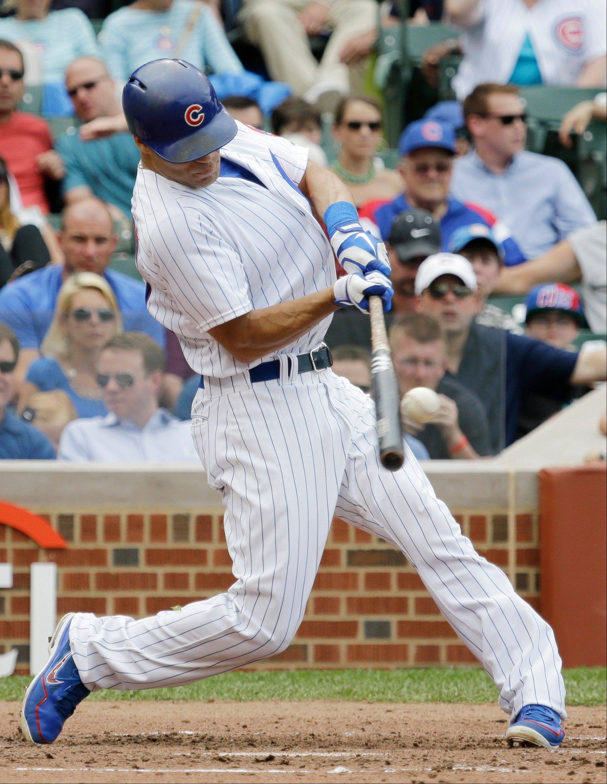 The Cubs' Scott Hairston blasts a grand slam against the Diamondbacks in the third inning Friday at Wrigley Field.