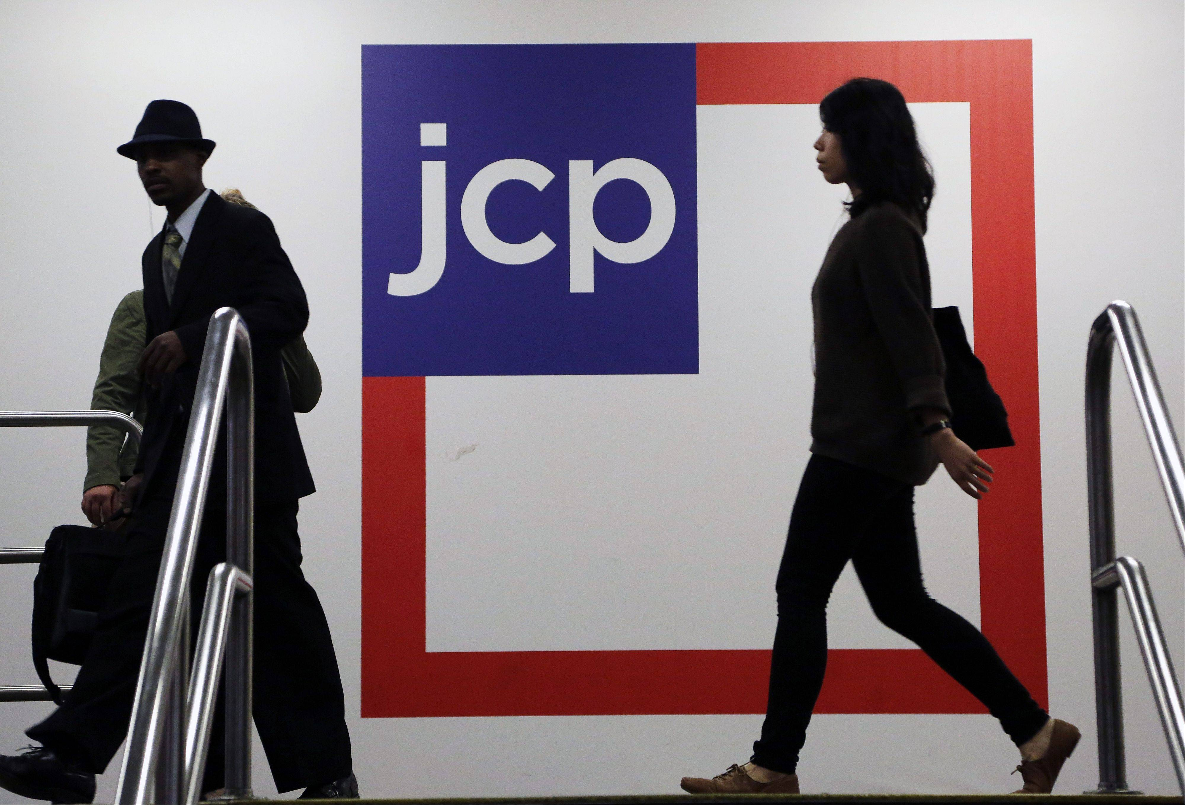 Customers shop at a J.C. Penney store, in New York. Americans cut back on spending in April after their income failed to grow, a sign economic growth may be slowing, according to data released by the Commerce Department, Friday.