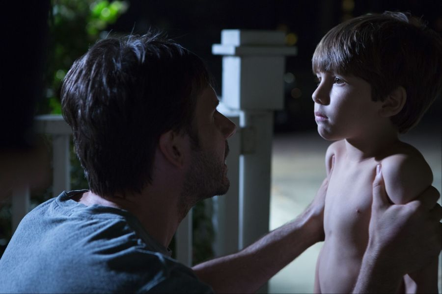 "A father (Josh Hamilton) finds his son (Dakota Goyo) under a mysterious trance in the thriller ""Dark Skies."""