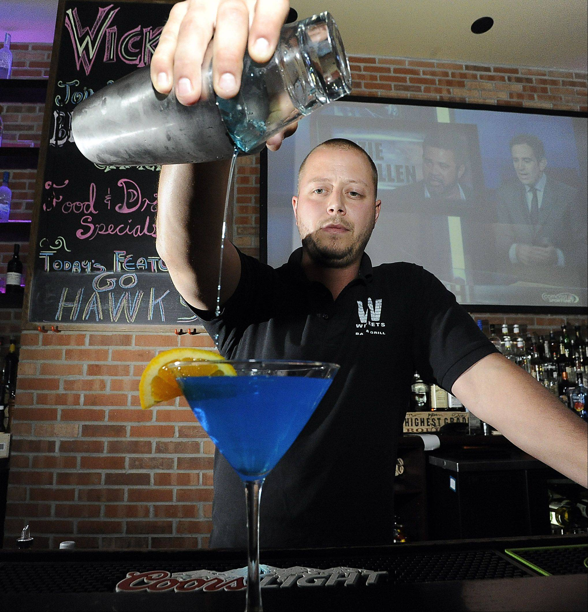 Bartender Joe Catomer mixes a summer drink at Wickets Bar and Grill in Schaumburg.
