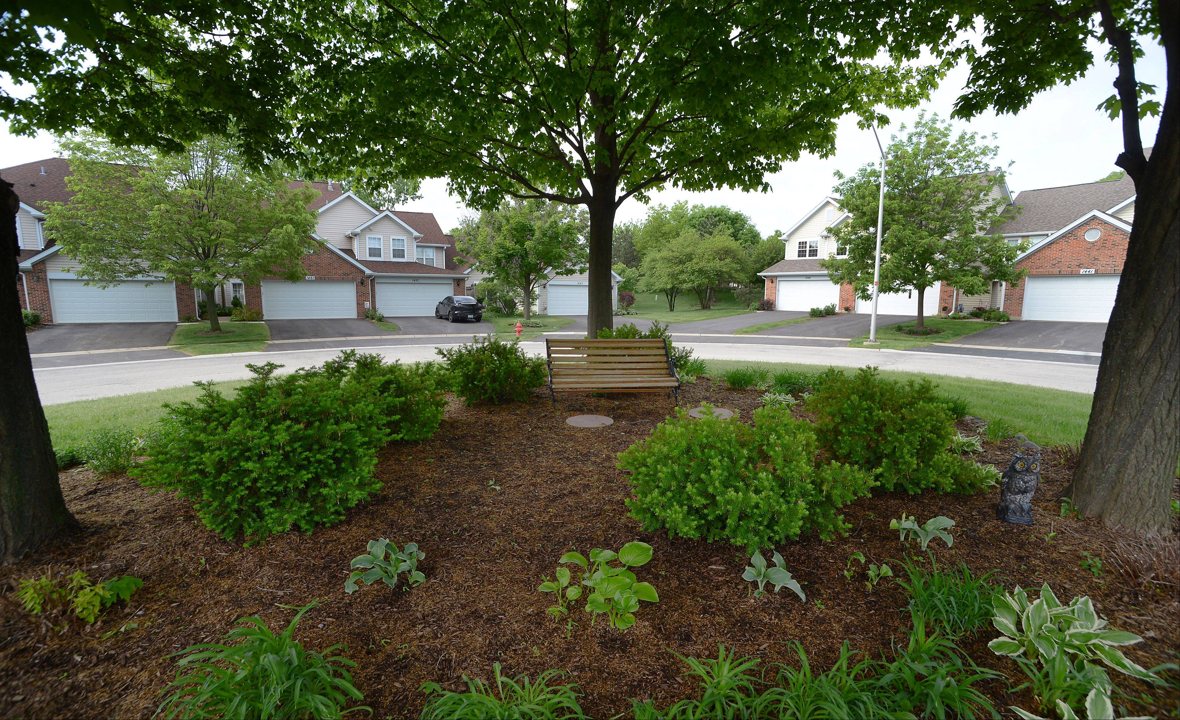 Residents can enjoy a small park nestled beneath the trees at the center of the Autumn Ridge community.