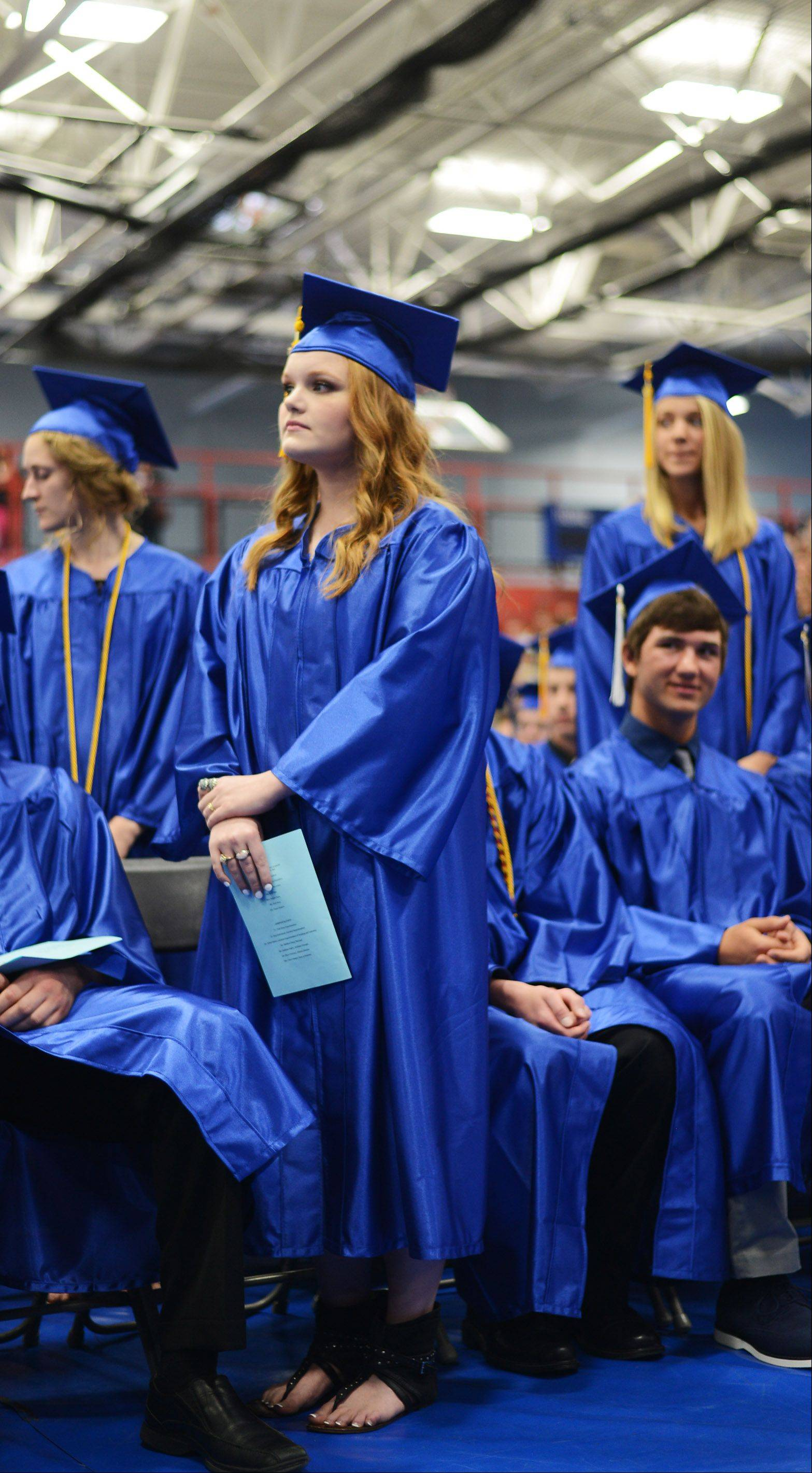 Graduate Taylor Austin earns her degree with honors at the Burlington Central High School graduation ceremony Friday, May 31 at Elgin Community College in Elgin.