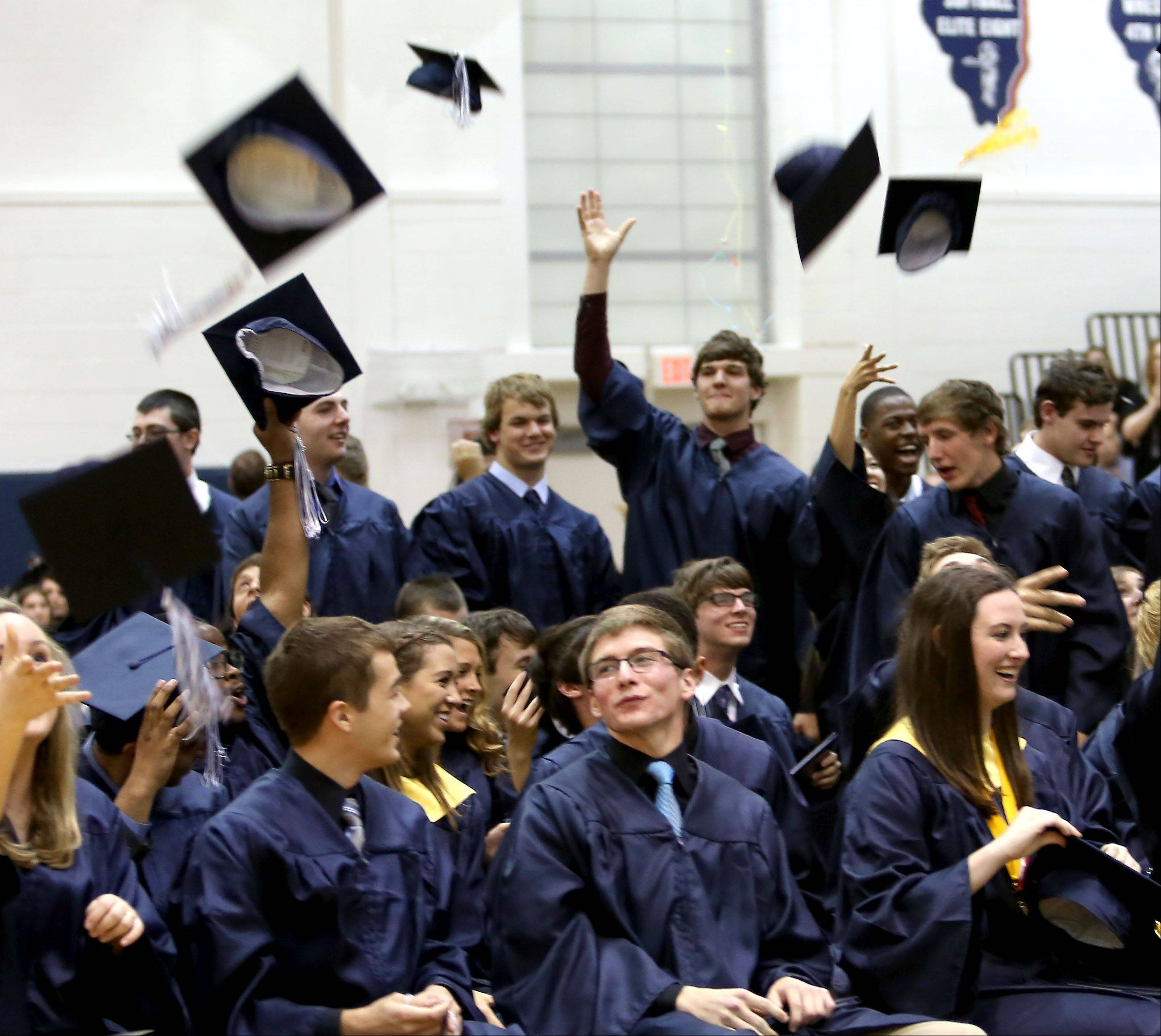 Caps go up in the air after the graduation at Lisle High School on Friday.