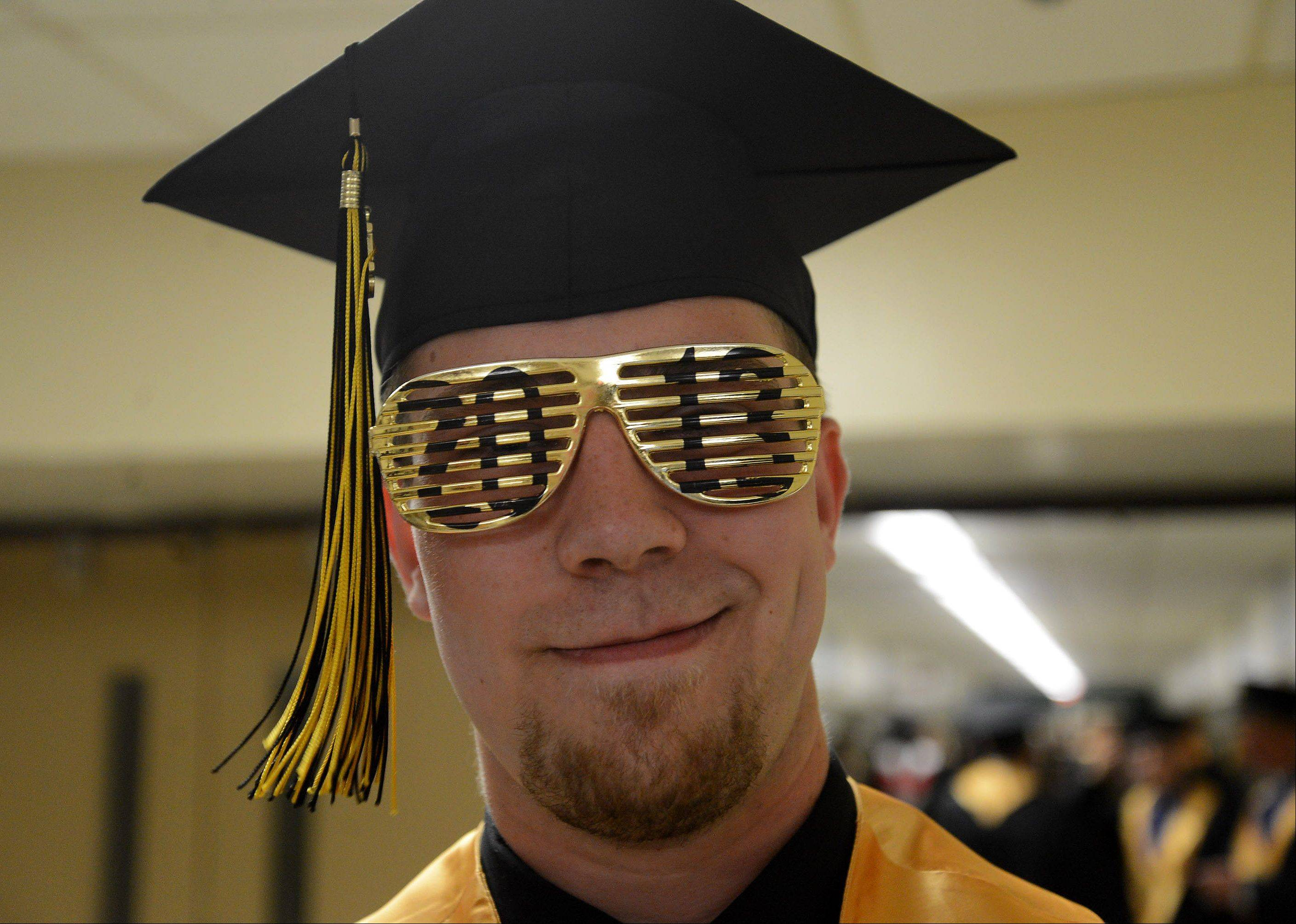 Eric Schroeder dons 2013 glasses as he waits for the Glenbard North High School graduation to begin.