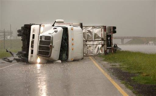 Overturned trucks block a frontage road off I-40 just east of 81 in El Reno, Okla., after a tornado moved through the area on Friday, May 31, 2013.