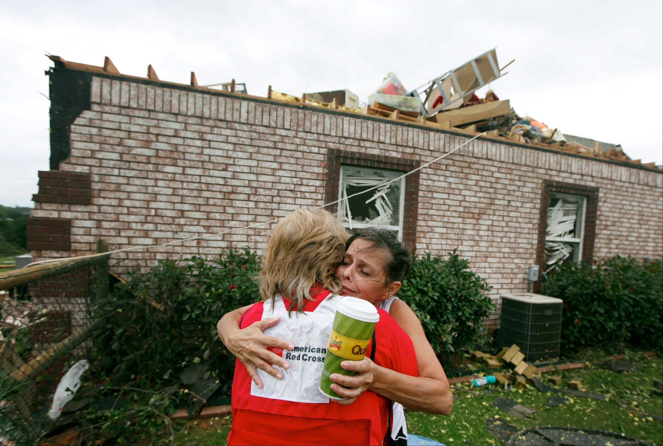 Belinda Russell hugs Red Cross worker Sue Morey Friday after surveying damage to her home in the Rolling Meadow Estates neighborhood in Broken Arrow, Okla. after a tornado passed the area overnight. Residents braced again for bad weathr Friday night as a powerful storm system spawned numerous tornadoes.