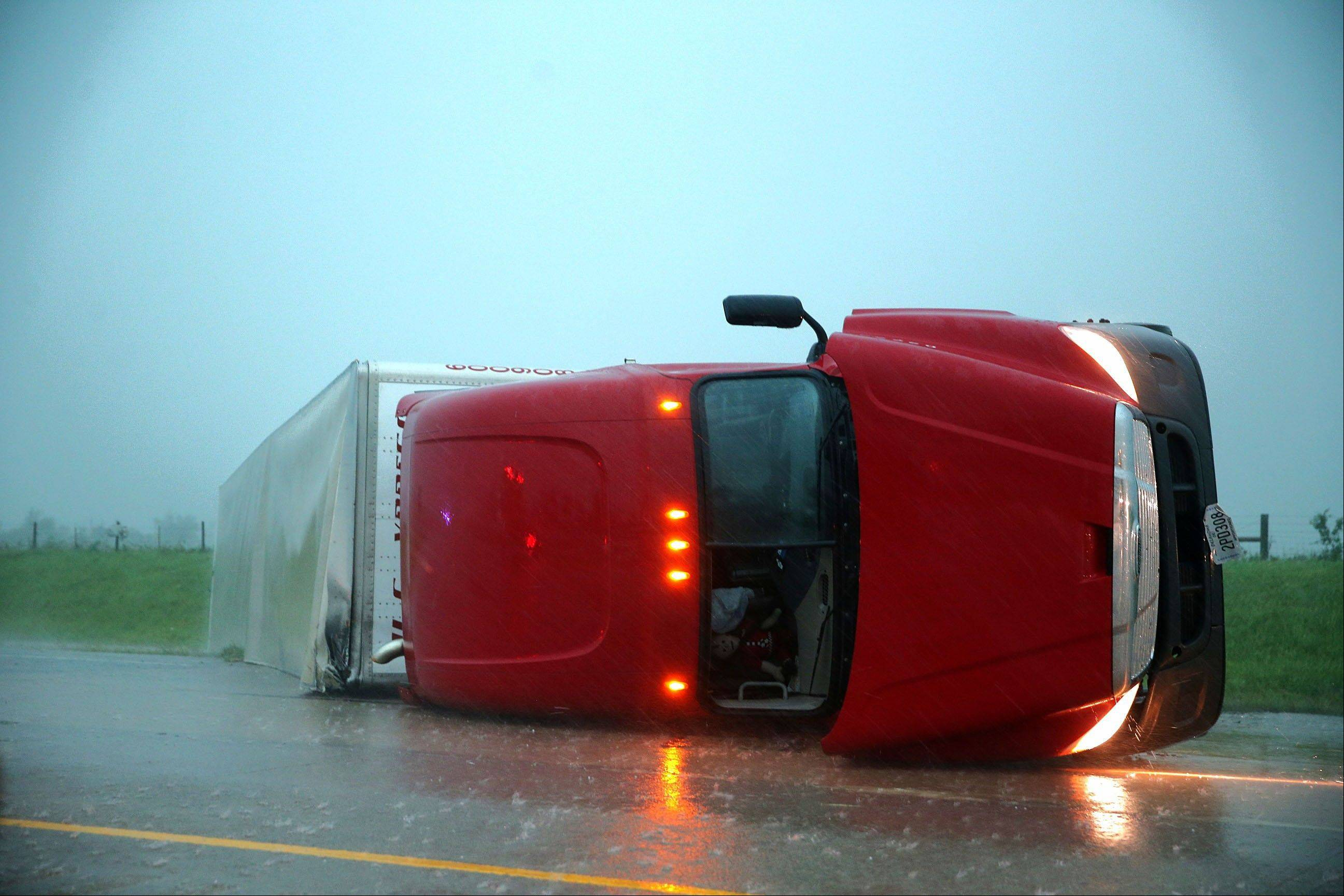 Associated Press An overturned semitrailer rests on its side Friday on the eastbound lanes of Interstate 40, just east of El Reno, Okla., after a tornado touched down.