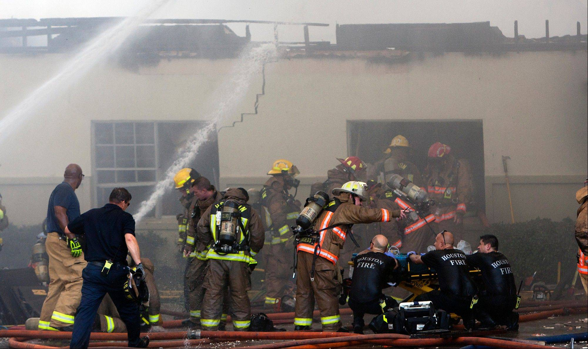 Flames spread and were shooting from the roof, blanketing the area in thick smoke, before firefighters extinguished the blaze about two hours later.