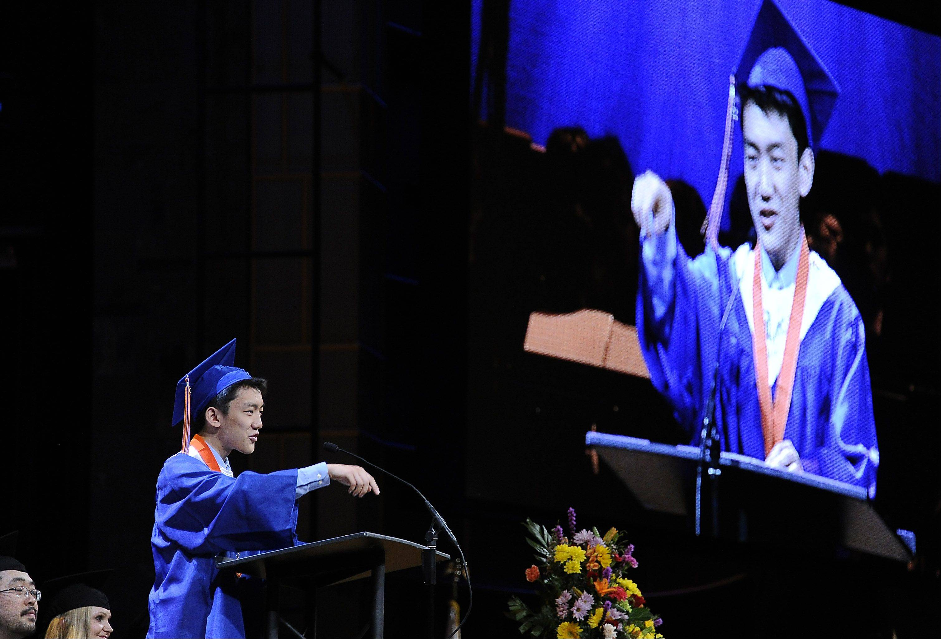 Hoffman Estates High School Academic Scholars' Representative of the Class of 2013, Yu Wang, speaks on Thursday.