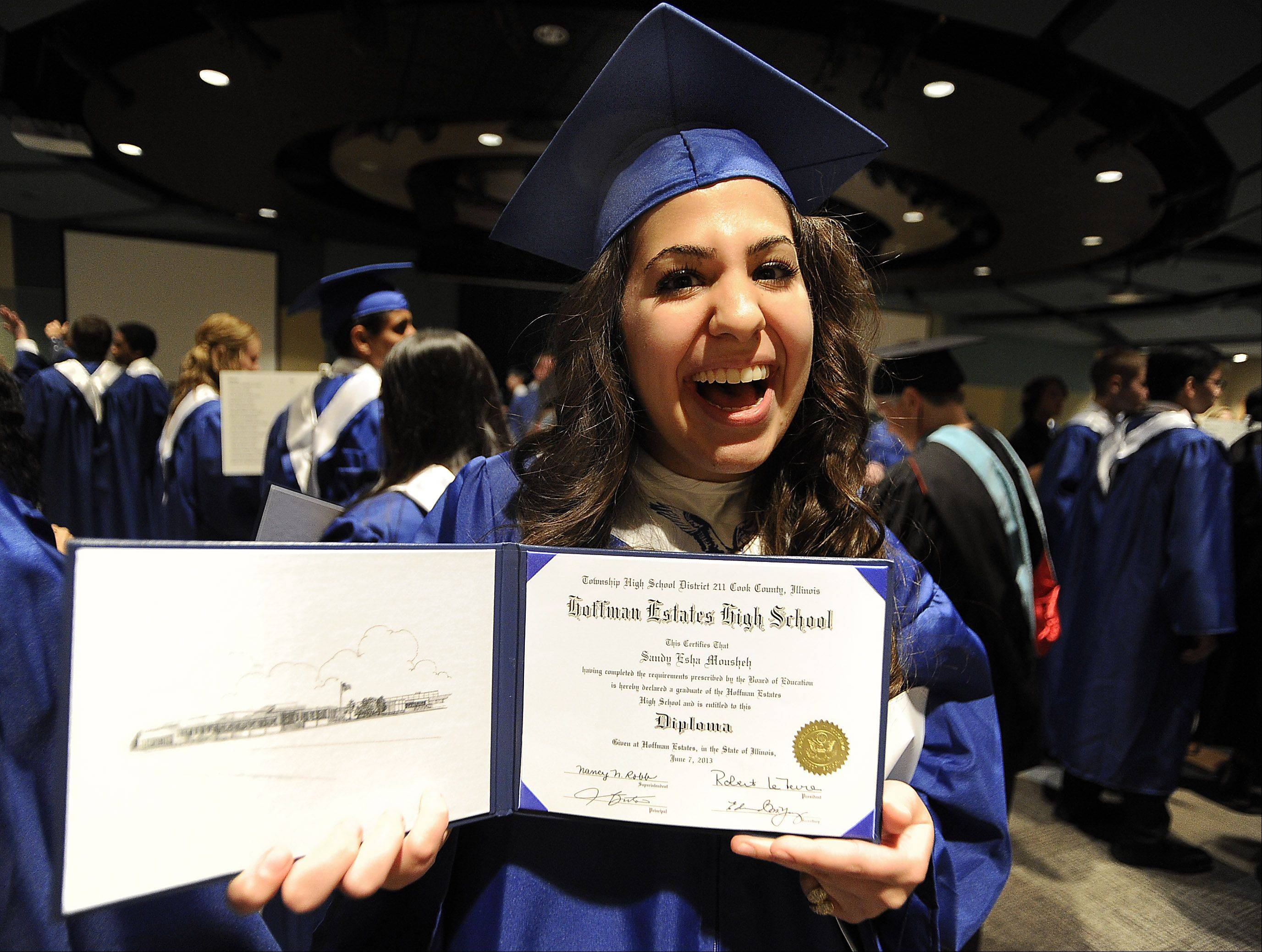 Hoffman Estates High School graduate Sandy Mousheh,18, of Hoffman Estates shows off her diploma .