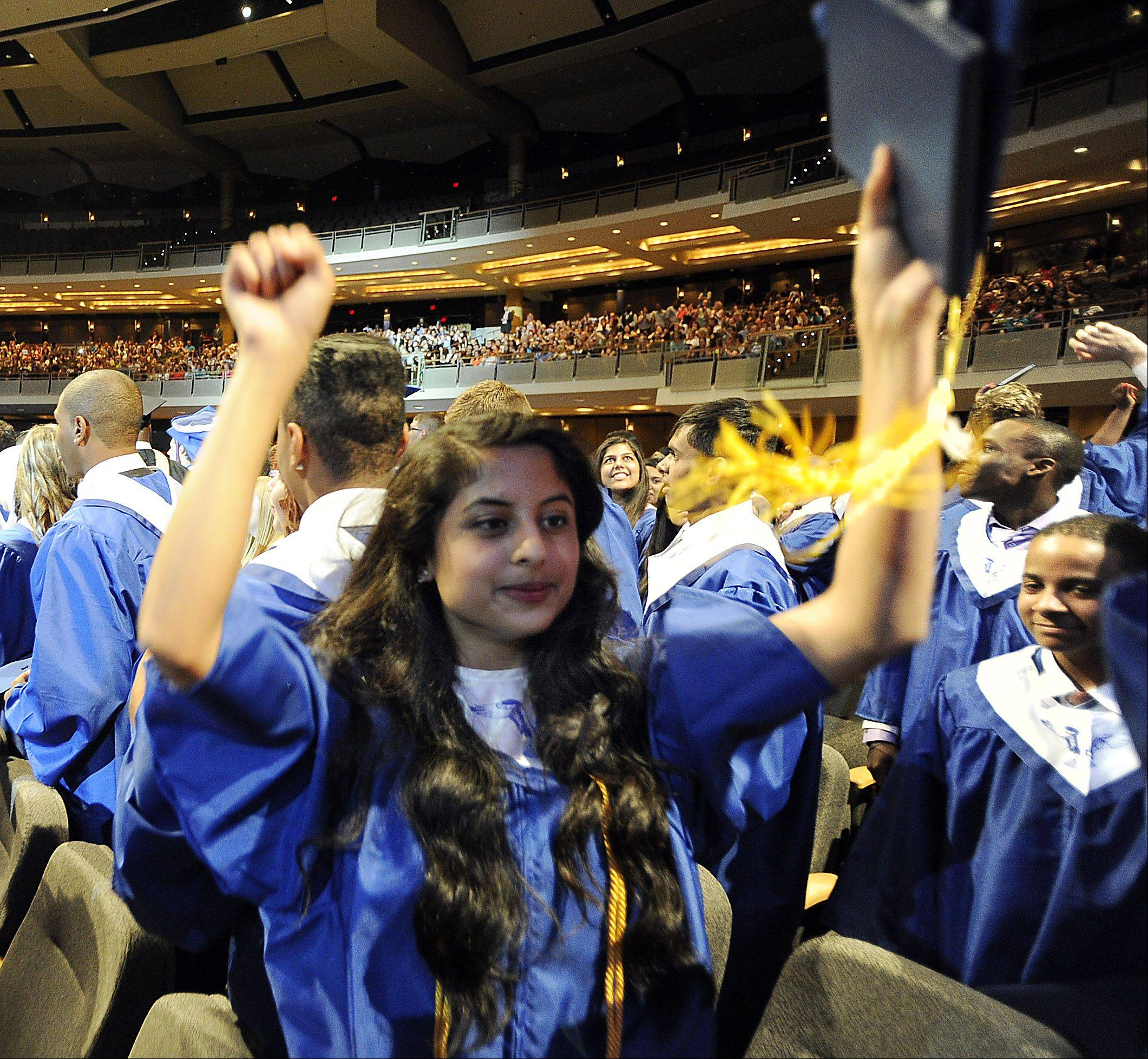 Hoffman Estates High School graduate Isha Jog ,18, of Schaumburg celebrates after receiving her diploma.