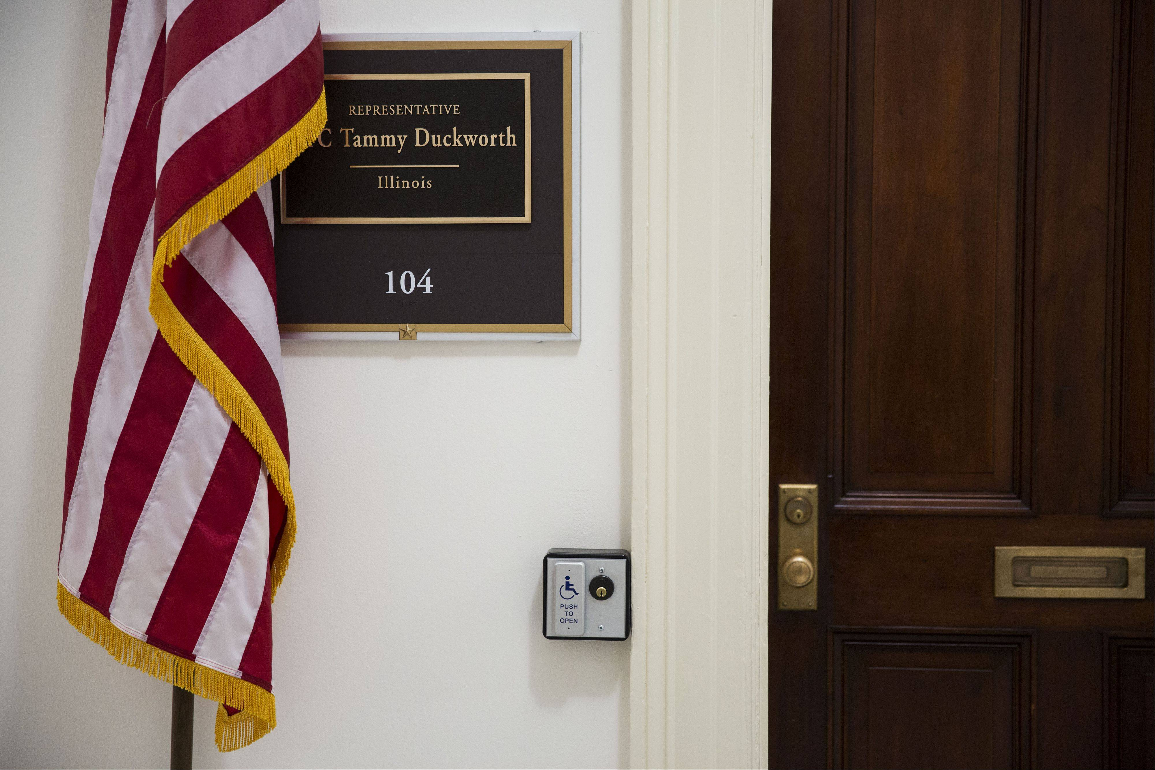 Democratic U.S. Rep. Tammy Duckworth encountered a basic hurdle as she prepared to move into her congressional office in Washington, D.C. -- the heavy wooden doors were impossible for a person in a wheelchair to open. She's since had an automatic opener installed.