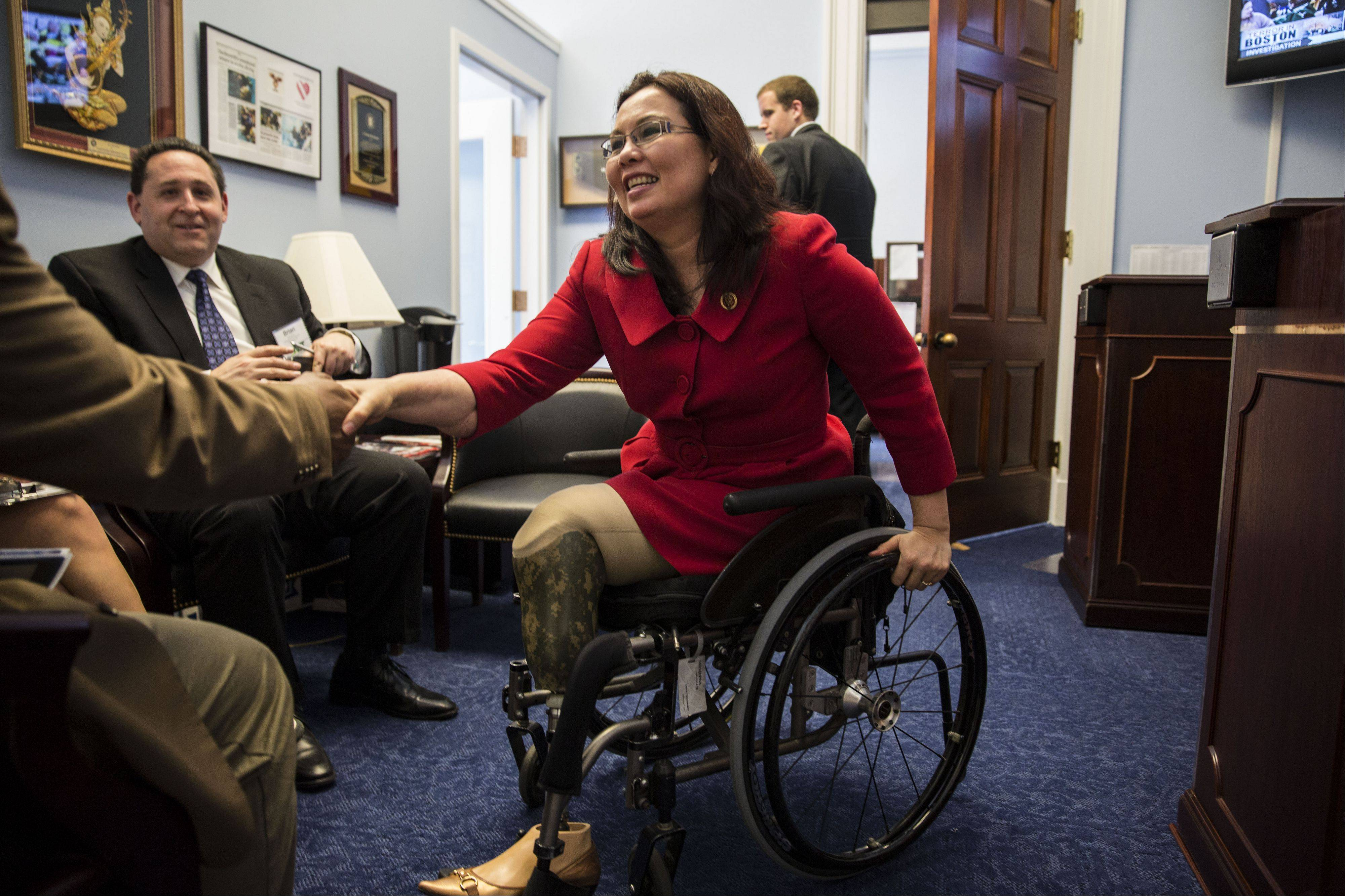 Democratic U.S. Rep. Tammy Duckworth of Hoffman Estates meets with constituents in her Cannon House congressional office in Washington, D.C.