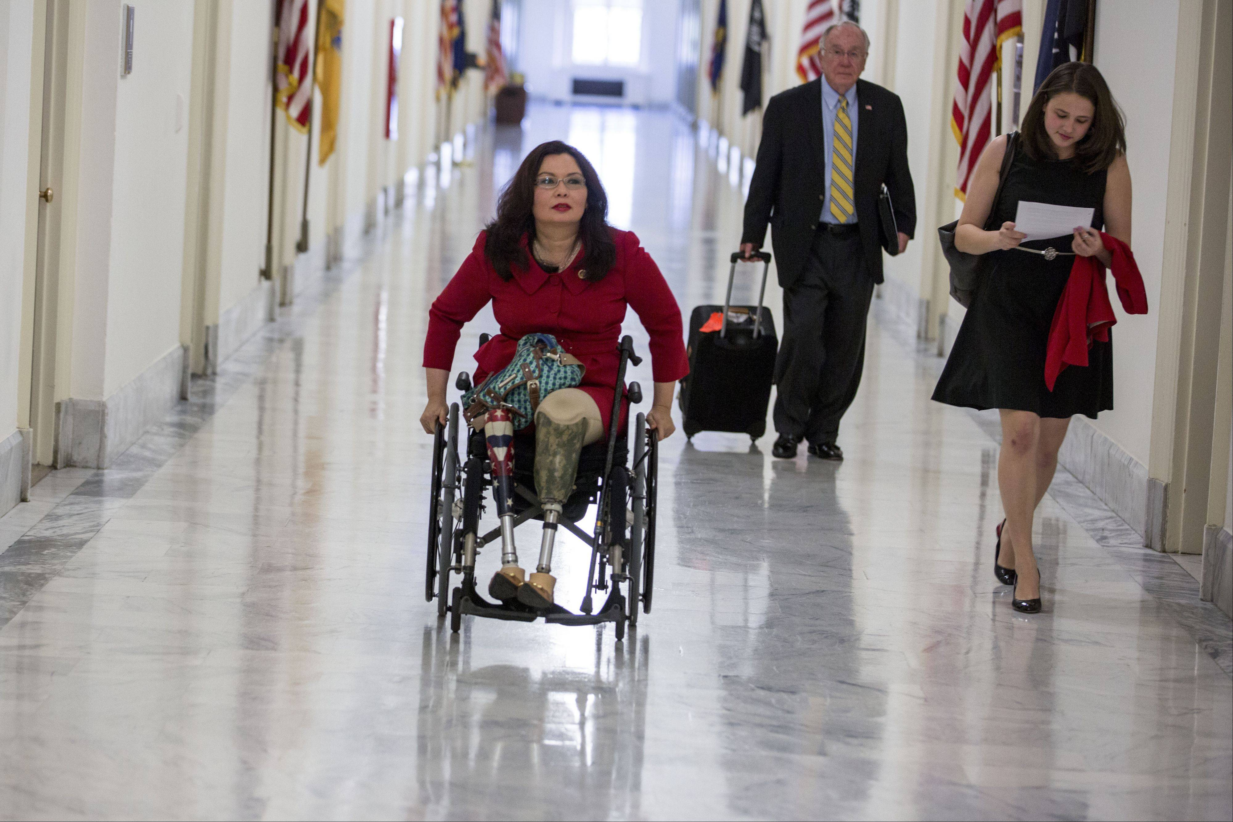 U.S. Rep. Tammy Duckworth of Hoffman Estates wheels down the hall of her office building in Washington. Duckworth, a double-amputee Iraq War veteran, aims to be a voice on veterans' and disability issues.