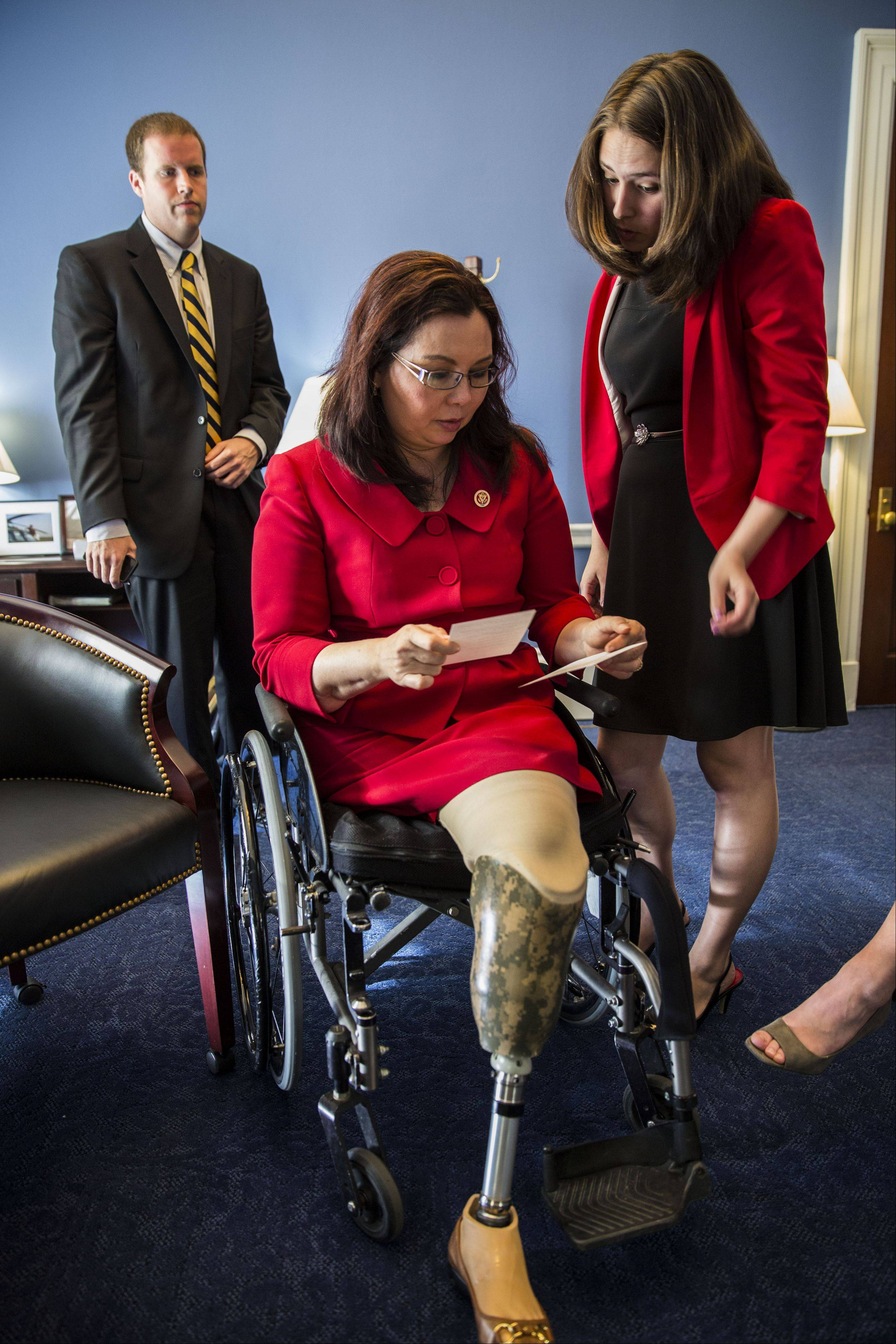 U.S. Rep. Tammy Duckworth of Hoffman Estates goes over constituent mail and scheduling with her staff in Washington, D.C.