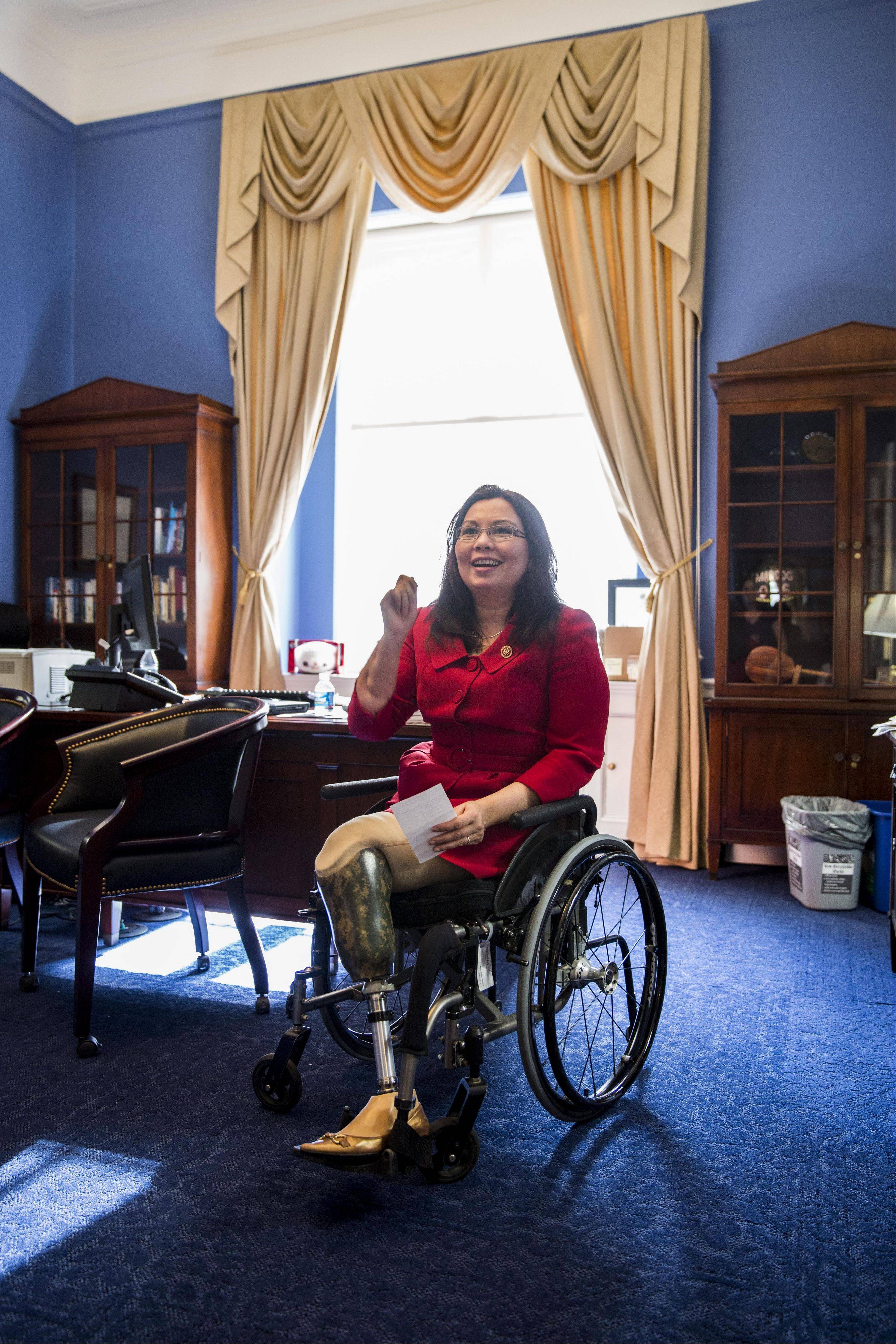 Democratic U.S. Rep. Tammy Duckworth of Hoffman Estates laughs while going over mail with staff in her office on Capitol Hill in Washington, D.C.