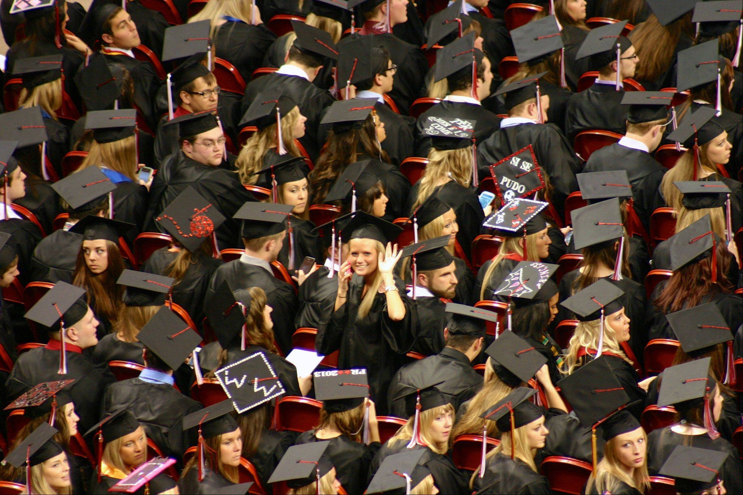 Carly Stinson shines as she waves to family among a sea of graduates at Redbird Arena at Illinois State University on May 10th.