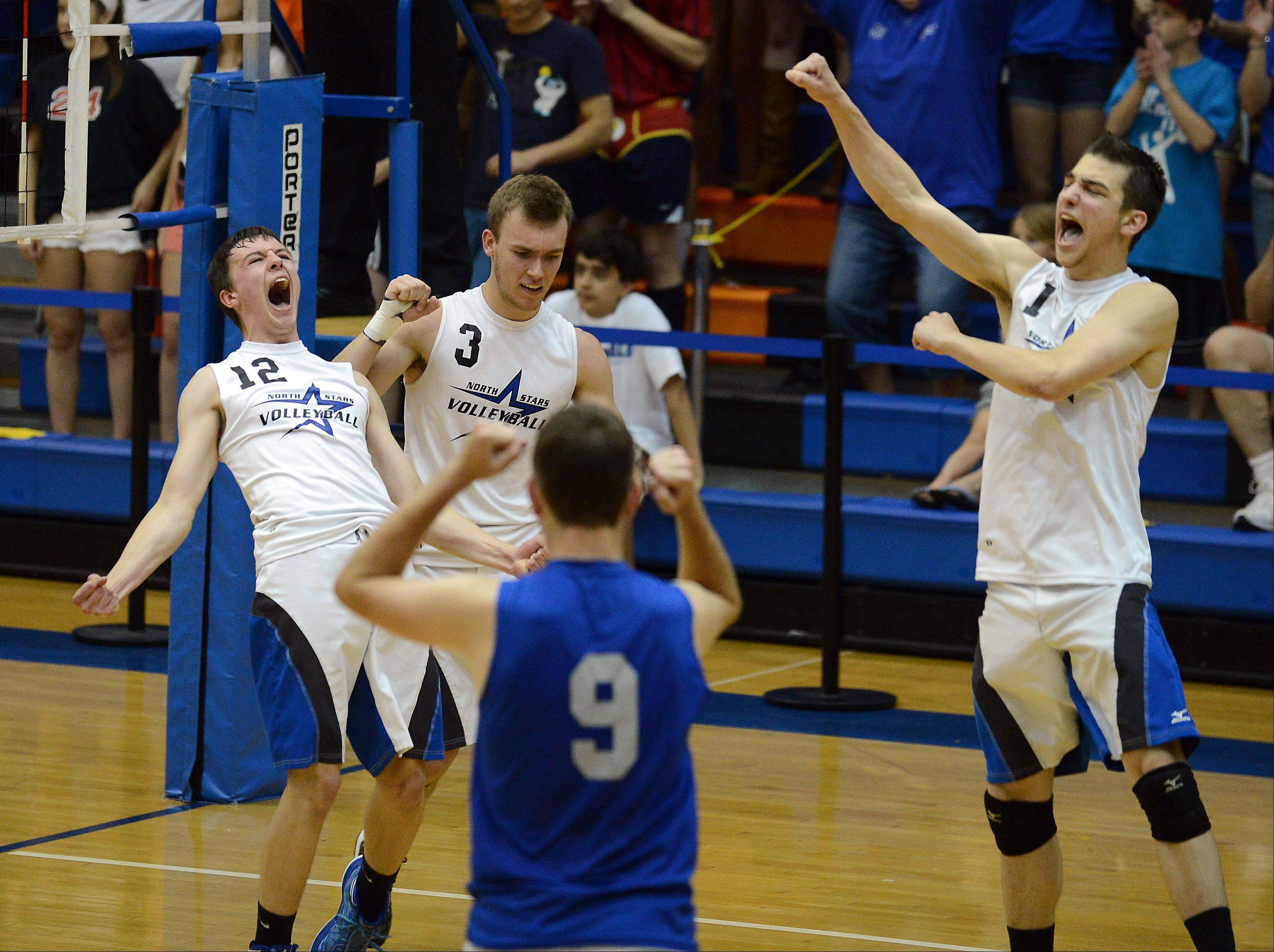 St. Charles North's Jake Hamilton and the rest of his teammates celebrate a point late in the third game heading towards their victory over Oak Park-River Forest in the best of three games at the boys volleyball state finals 2013 at Hoffman Estates High School on Friday.