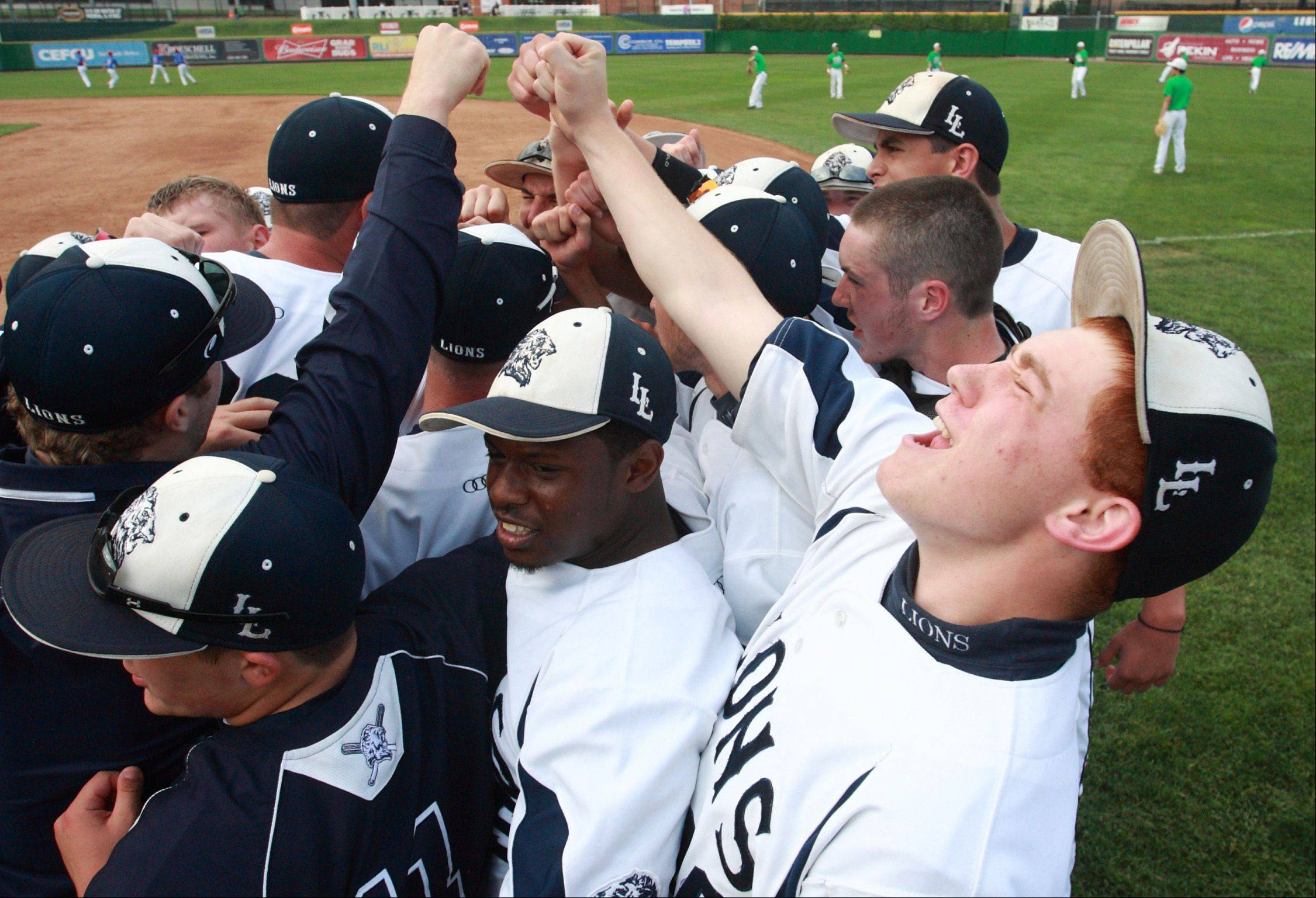 Lisle's Alex Ventrella celebrates the Lions' IHSA state semifinal baseball victory over Teutopolis with his team. The Lions defeated the Wooden Shoes 2-1 to advance to Saturday's title game at Dozer Park in Peoria.