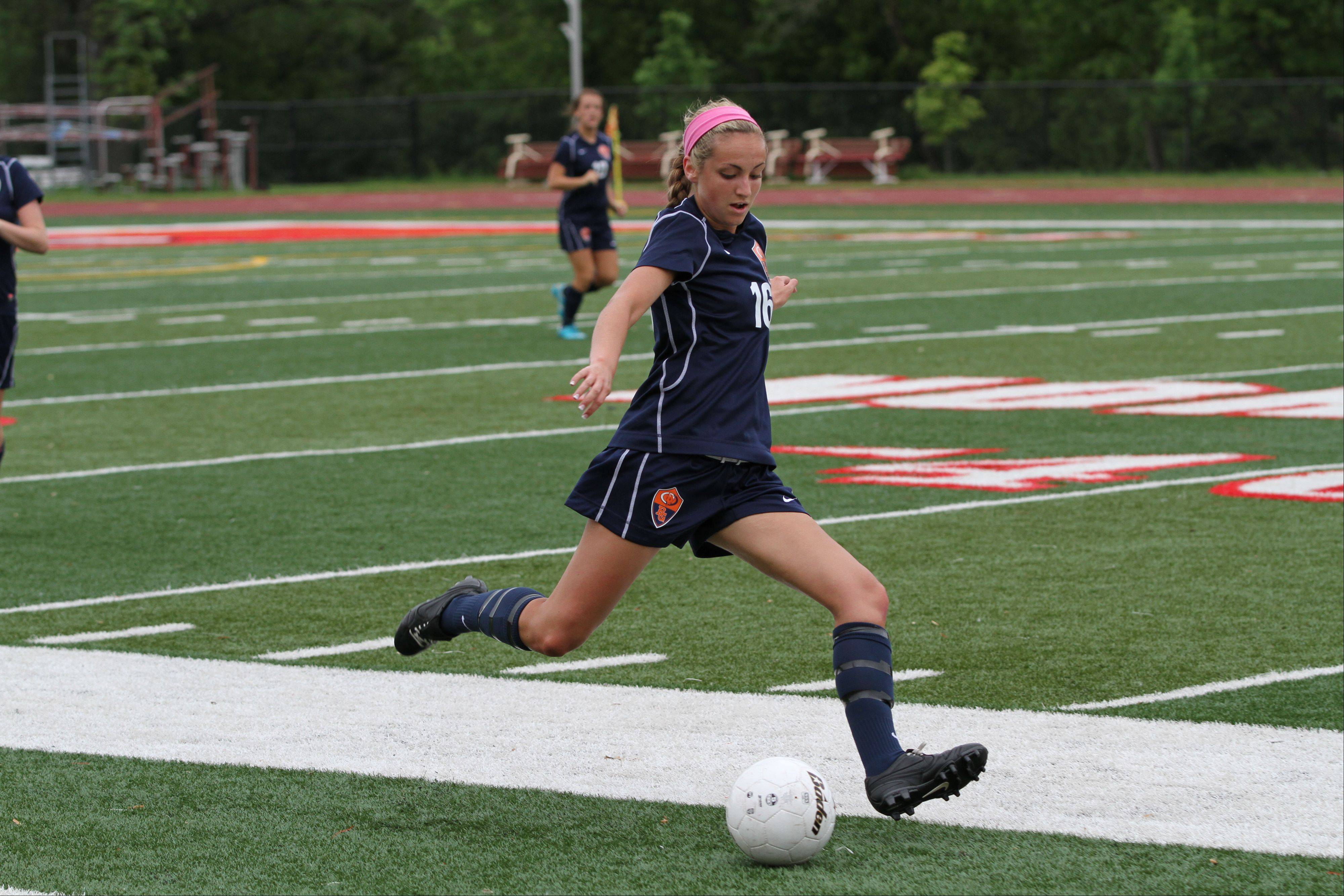 Buffalo Grove High School midfield Carly Brown kicks the ball at the girl soccer state semi-final game against Naperville North High School on Friday, May 31, 2013 at North Central College in Naperville, Ill.