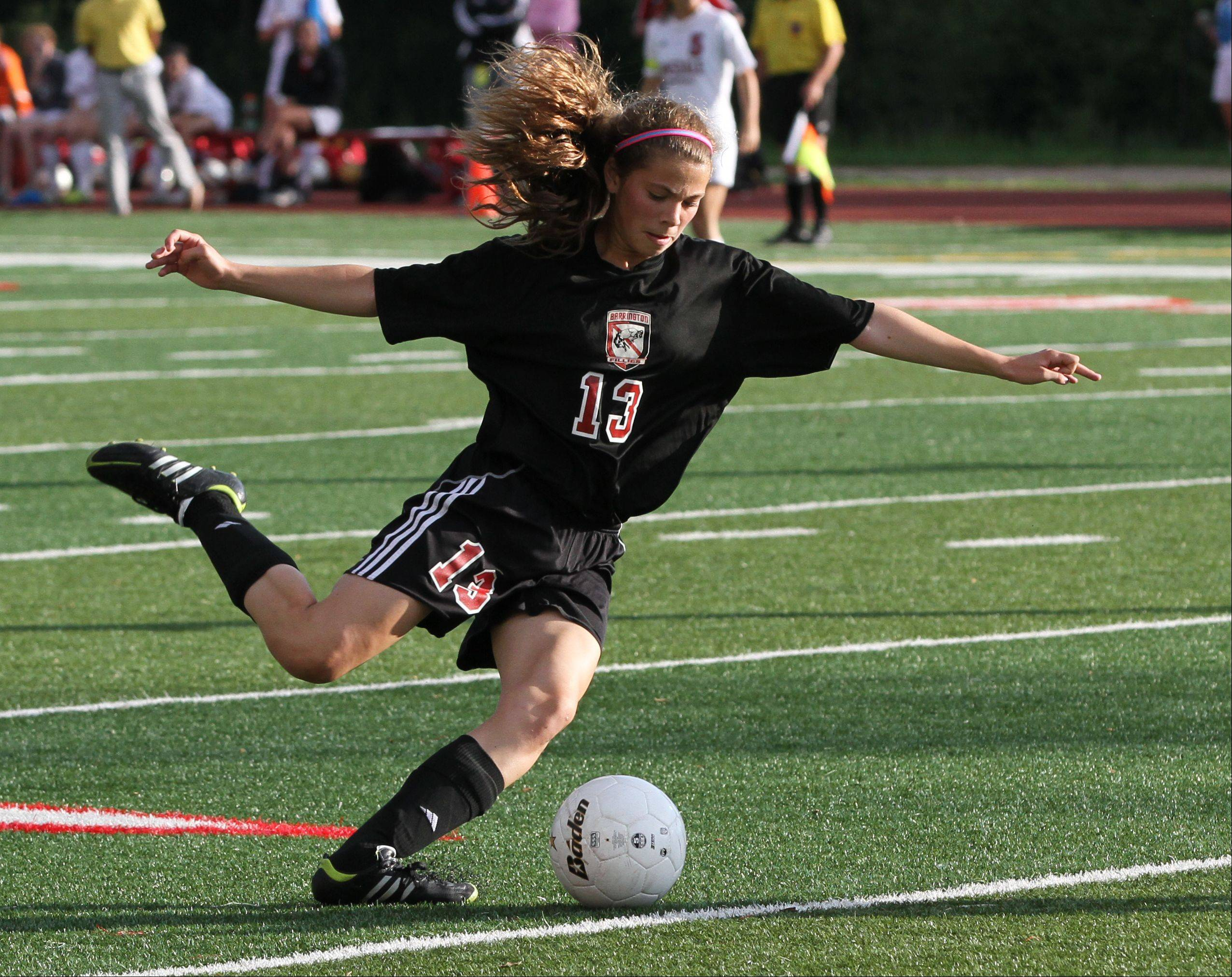 Barrington midfielder Kelsey Muniz kicks the ball downfield in the Class 3A girls soccer state semifinals against Hinsdale Central on Friday at North Central College.