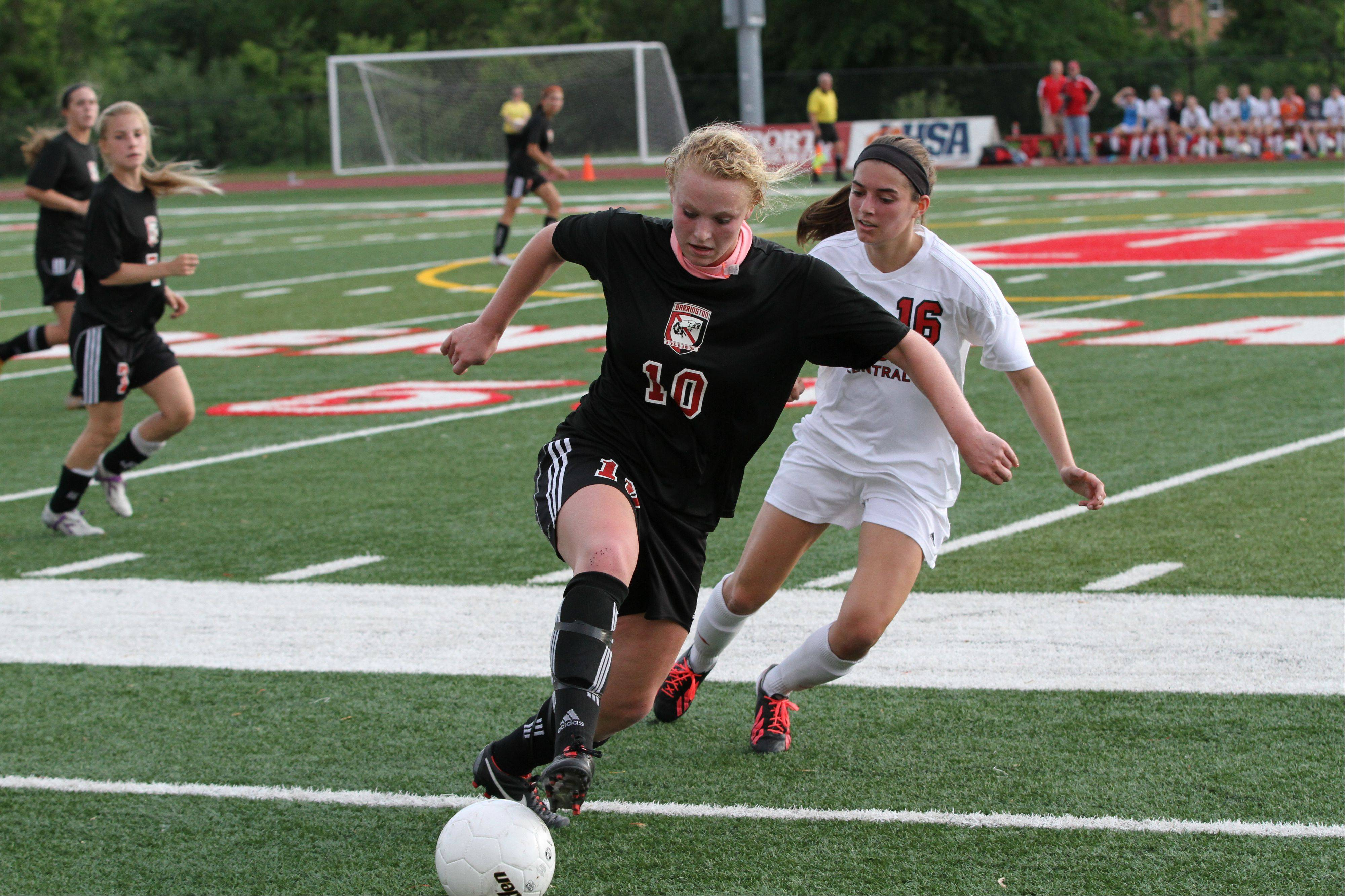 Barrington's Gabby McLaurin keeps the ball away from Hinsdale Central midfielder Katherine Treankler in the Class 3A girls soccer state semifinals Friday at North Central College.