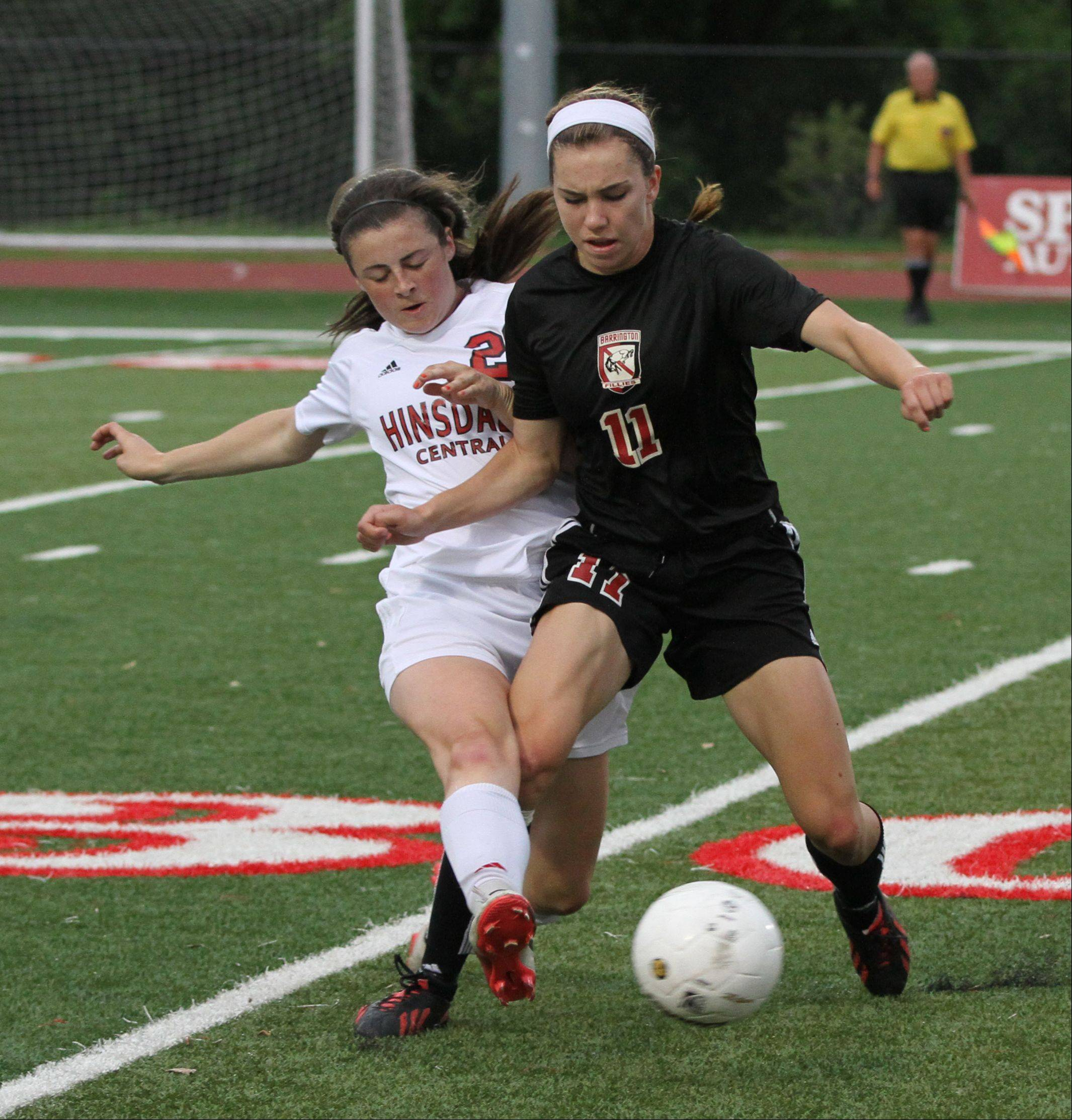 Hinsdale Central's Katie Camden, left, battles Barrington forward Jenna Szczesny in the Class 3A girls soccer state semifinals Friday at North Central College in Naperville.