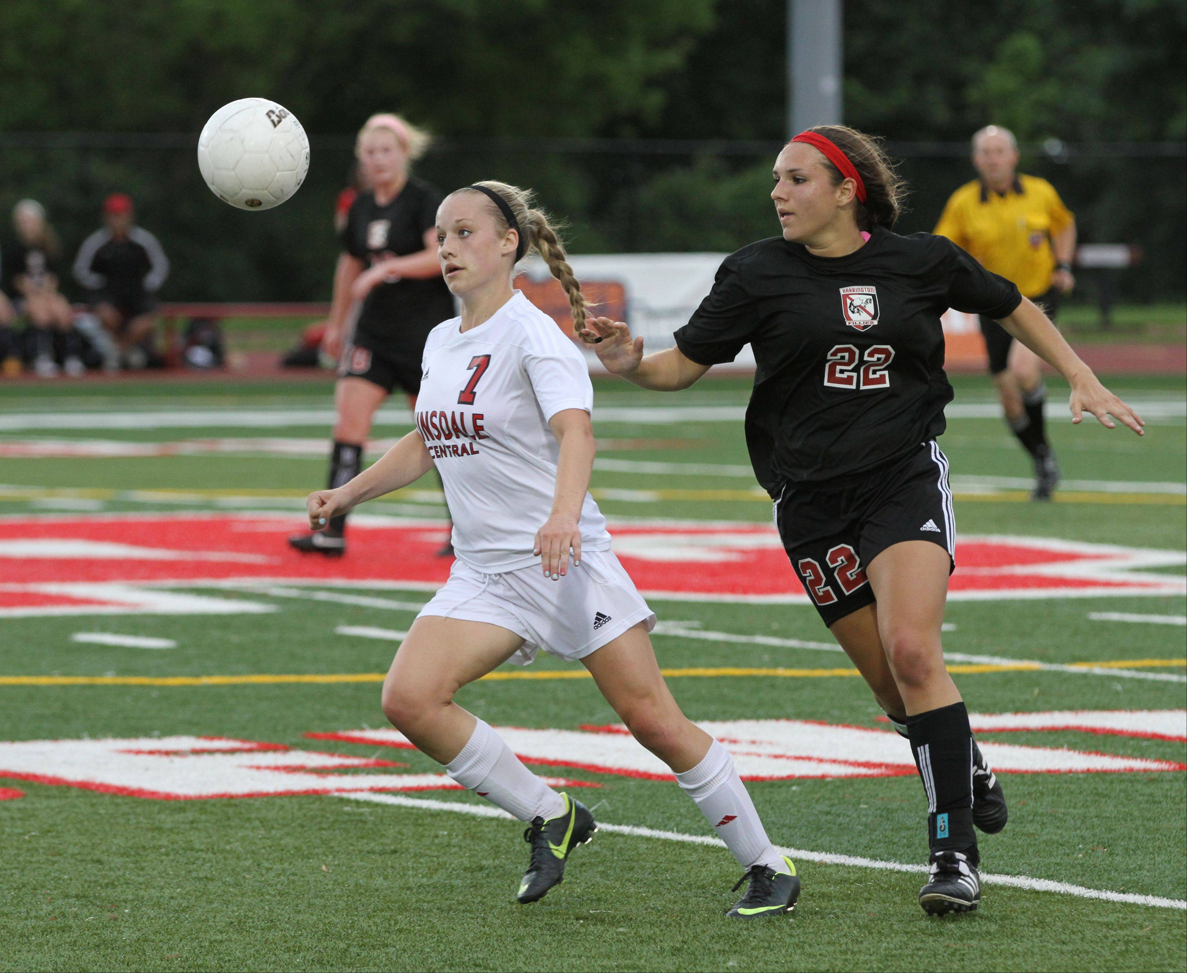 Hinsdale Central's Alison Cerny, left, battles Barrington's Mia Calamari for the ball in the Class 3A girls soccer state semifinals Friday at North Central College. Cerny had the goal in the Red Devils' 1-0 victory.