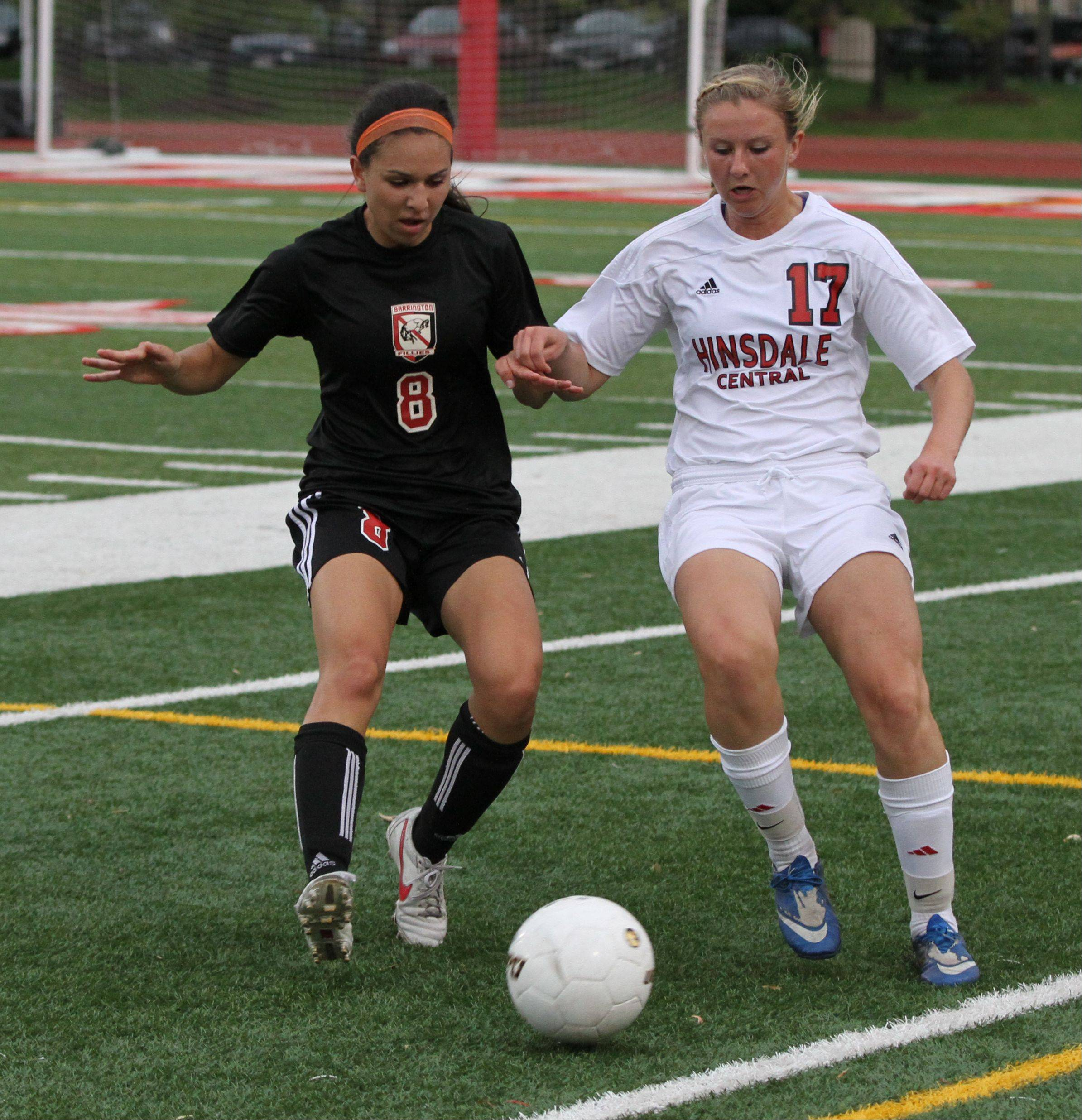 Barrington midfielder Aimee Pierce battles Hinsdale Central midfielder Lily Chetosky for the ball in the Class 3A girls soccer state semifinals Friday at North Central College.