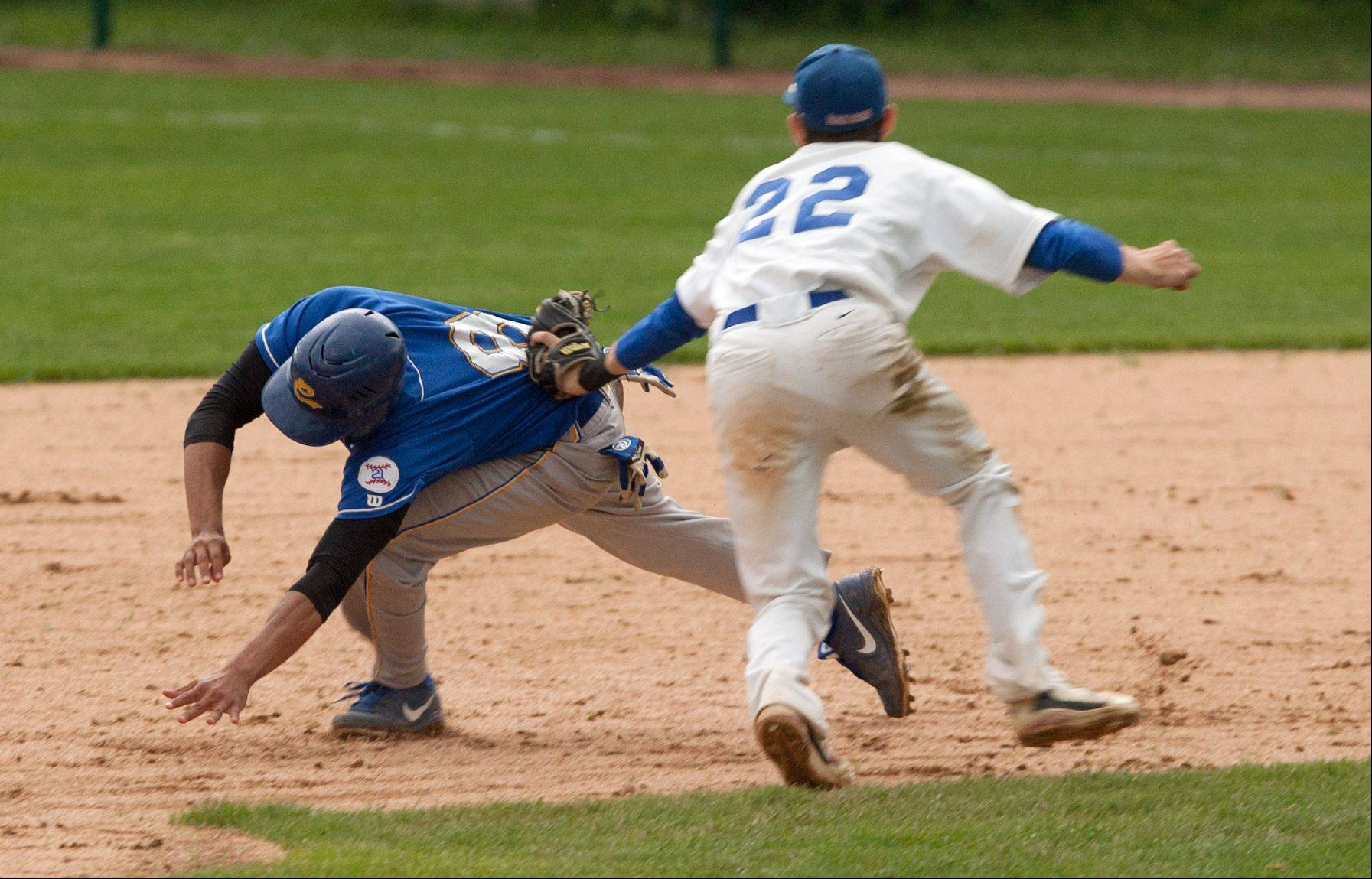 Glenbard South's Carl Sanders, right, applies the tag on Clemente's Jerimiah Figueroa, who was picked off first base during the Nazareth Class 4A sectional semifinals in LaGrange Park.