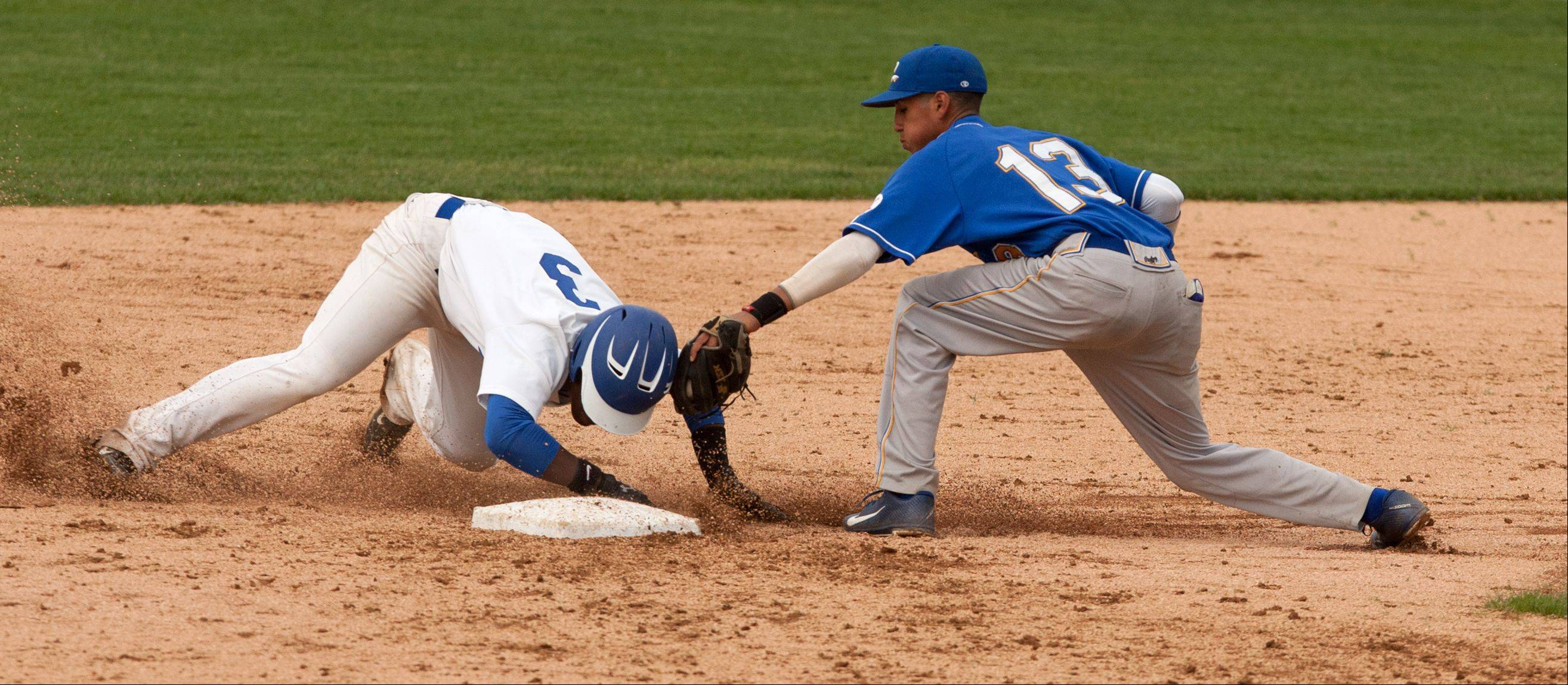 Glenbard South' Zach Smith safely slides around the tag of Clemente's Anthony Justiniano during the Nazareth Class 4A sectional semifinals in LaGrange Park.