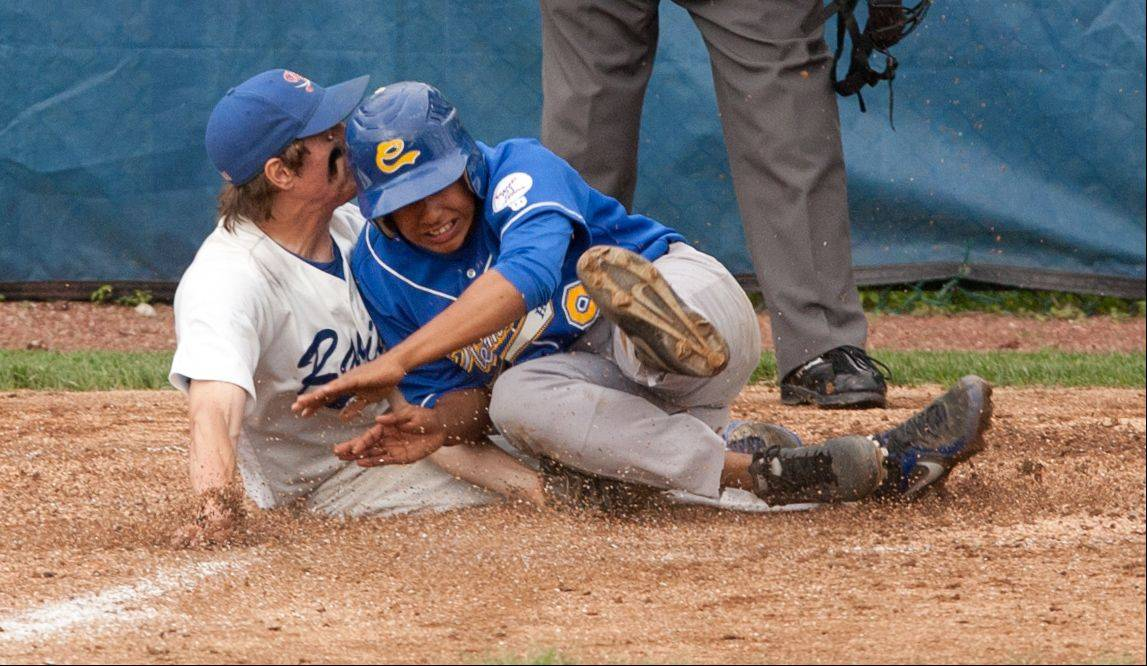 Glenbard South pitcher Ethan Gasbarro covers the plate to tag out Clemente's Ruben Olavarria, right, during the Nazareth Class 4A sectional semifinals in LaGrange Park.