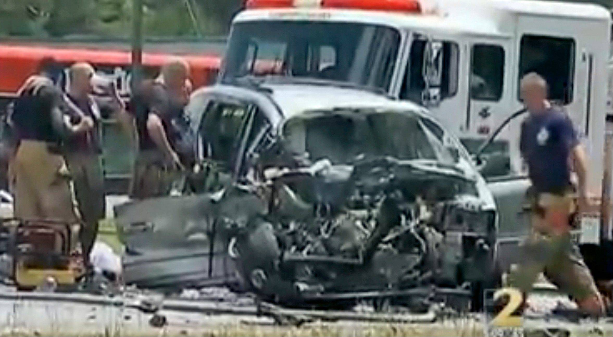 "In this image taken from video, emergency personnel work the scene of a car crash Friday, May 31, 2013, in Jonesboro, Ga. Former NBA All-Star guard Daron ""Mookie"" Blaylock was on life support at a hospital Friday after his SUV crossed the center line and crashed head-on into a van in suburban Atlanta, police said. Clayton County (Ga.) police spokesman Clarence Cox says the man and woman riding in the van were also injured and to the hospital. Their names and conditions were not immediately available. (AP Photo/WSB-TV) MANDATORY CREDIT"