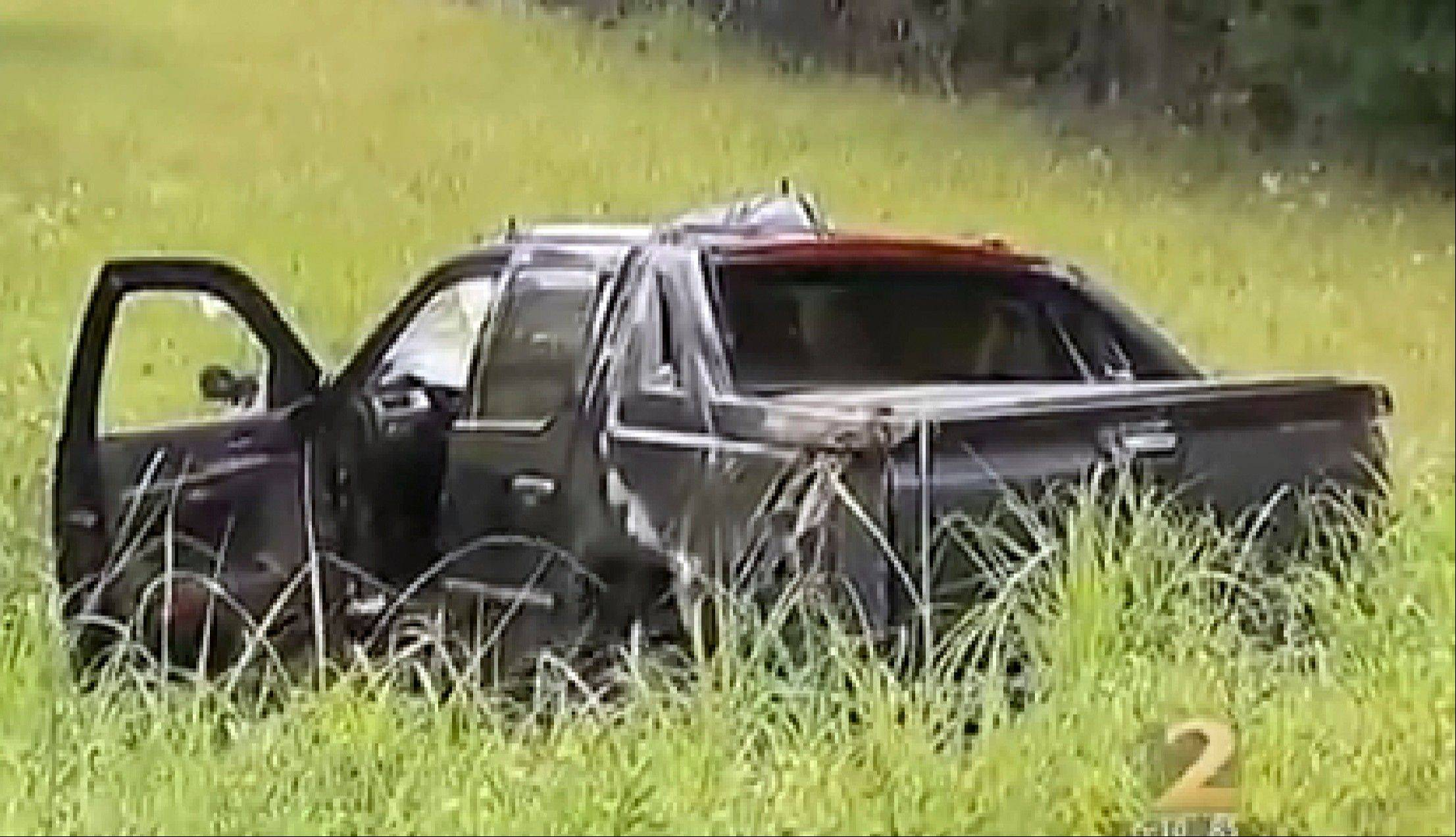 "In this image taken from video, an SUV sits off road at the scene of a car crash Friday, May 31, 2013, in Jonesboro, Ga. Former NBA All-Star guard Daron ""Mookie"" Blaylock was on life support at a hospital Friday after his SUV crossed the center line and crashed head-on into a van in suburban Atlanta, police said. Clayton County (Ga.) police spokesman Clarence Cox says the man and woman riding in the van were also injured and to the hospital. Their names and conditions were not immediately available. (AP Photo/WSB-TV) MANDATORY CREDIT"