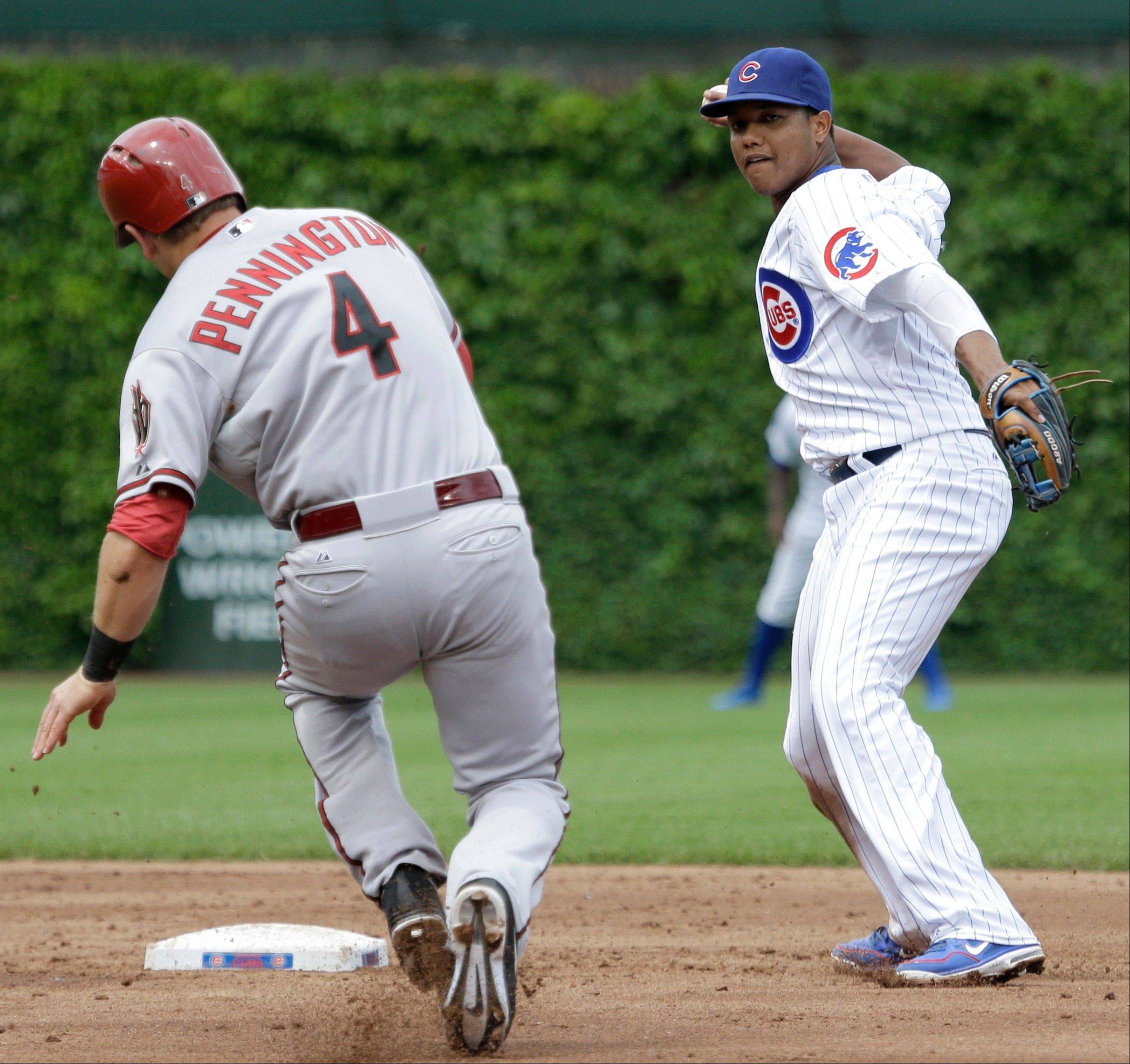 Chicago Cubs shortstop Starlin Castro, right, throws to first after forcing out Arizona Diamondbacks' Cliff Pennington during the third inning of a baseball game, Friday, May 31, 2013, in Chicago. Wade Miley was out at first.