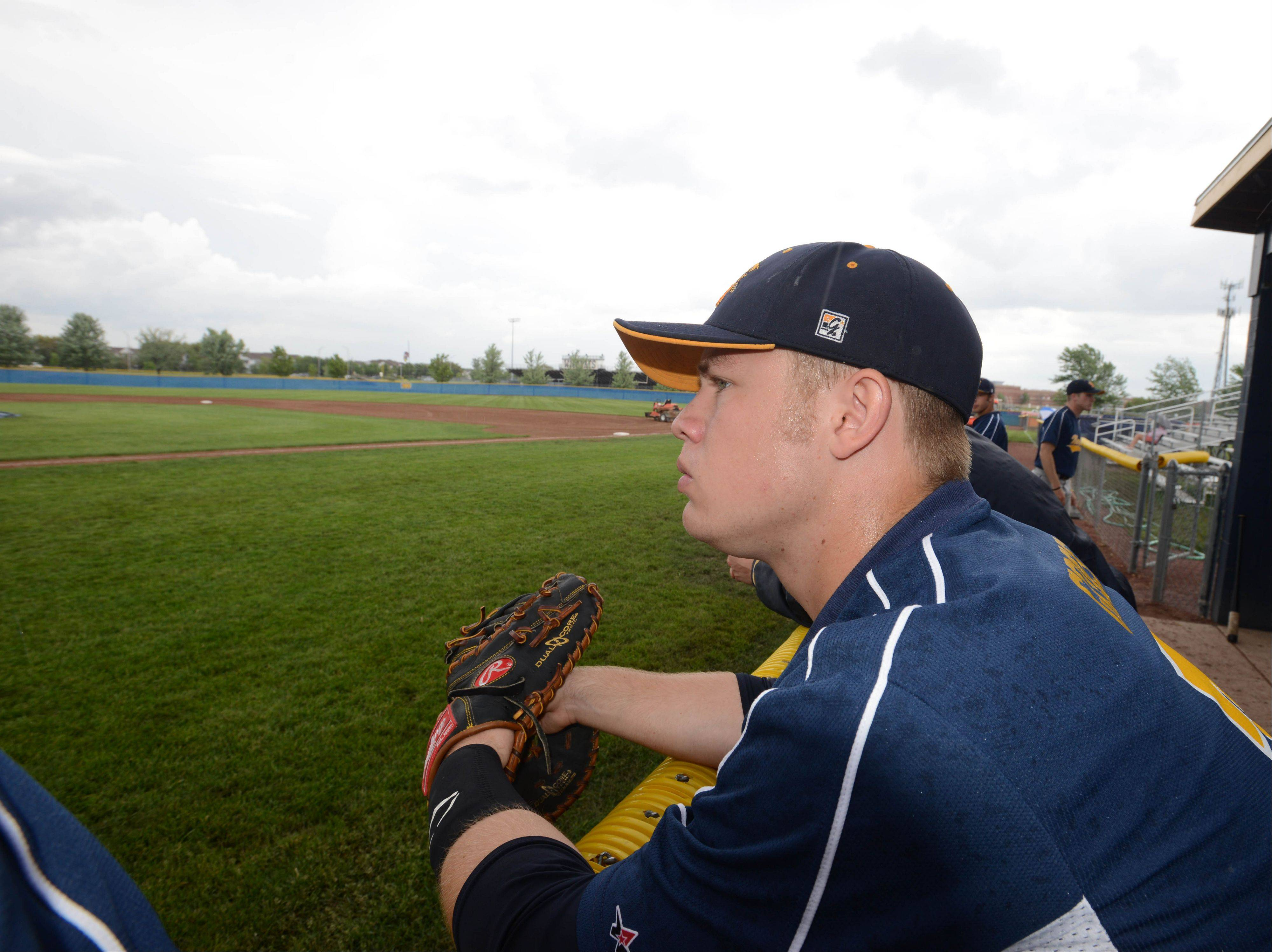 Dylan Goss of Neuqua looks glum while waiting for foul weather to pass before the start of the Neuqua Valley vs. Plainfield North Class 4A sectional semifinal game Thursday.