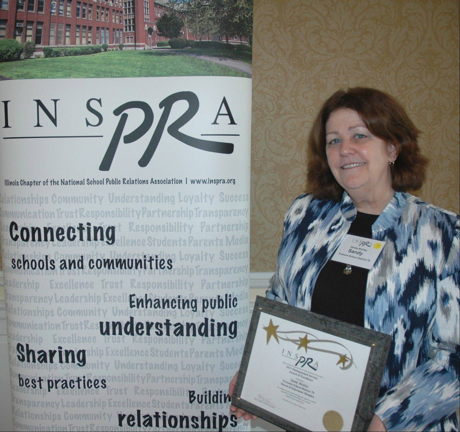 Fremont School District 79 Board President Sandra Bickley recently received a Distinguished Service Award for excellence from the Illinois School Public Relations Association.